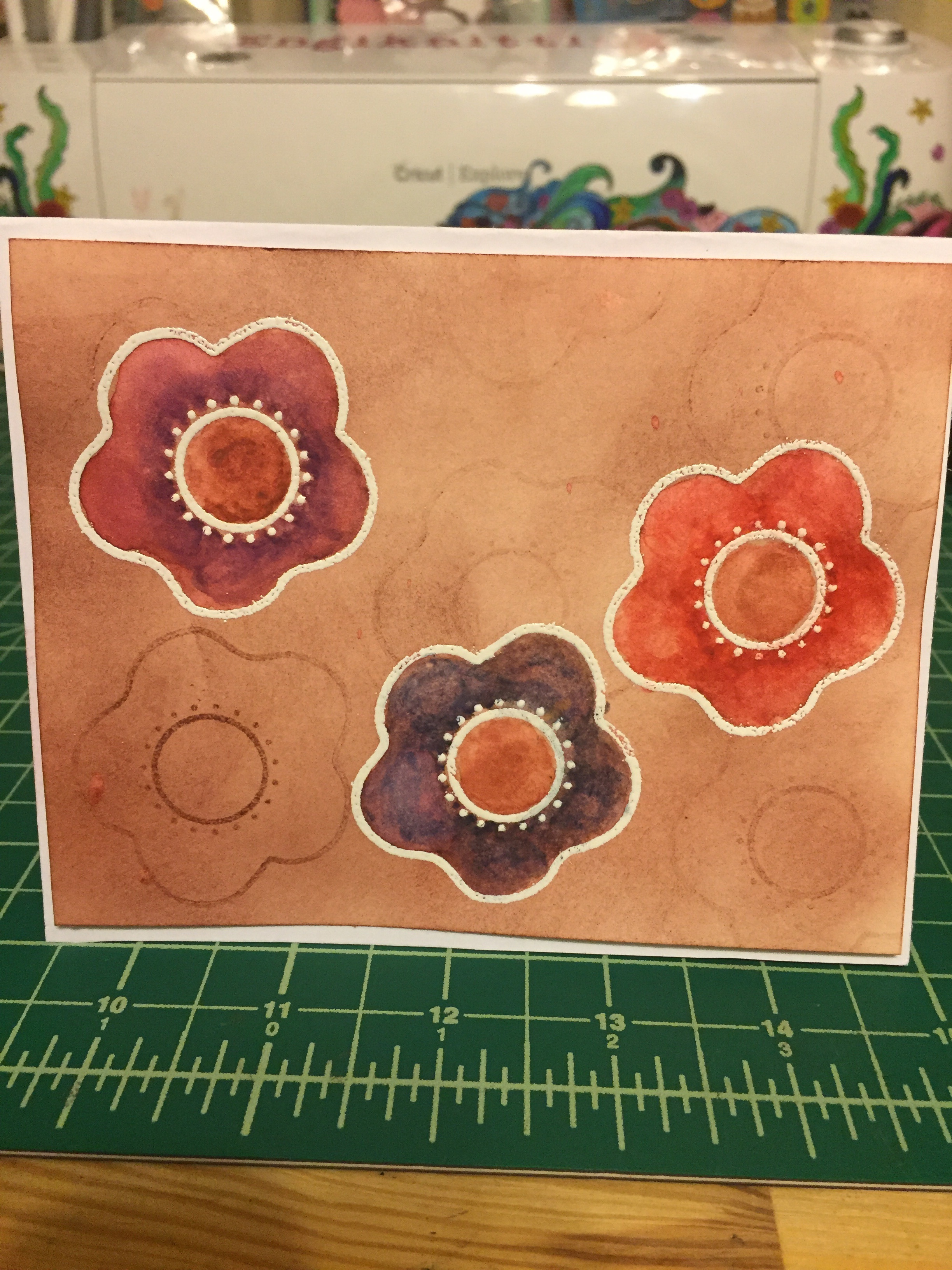 Done with embossing powder, watercolor pencils, and distress ink.