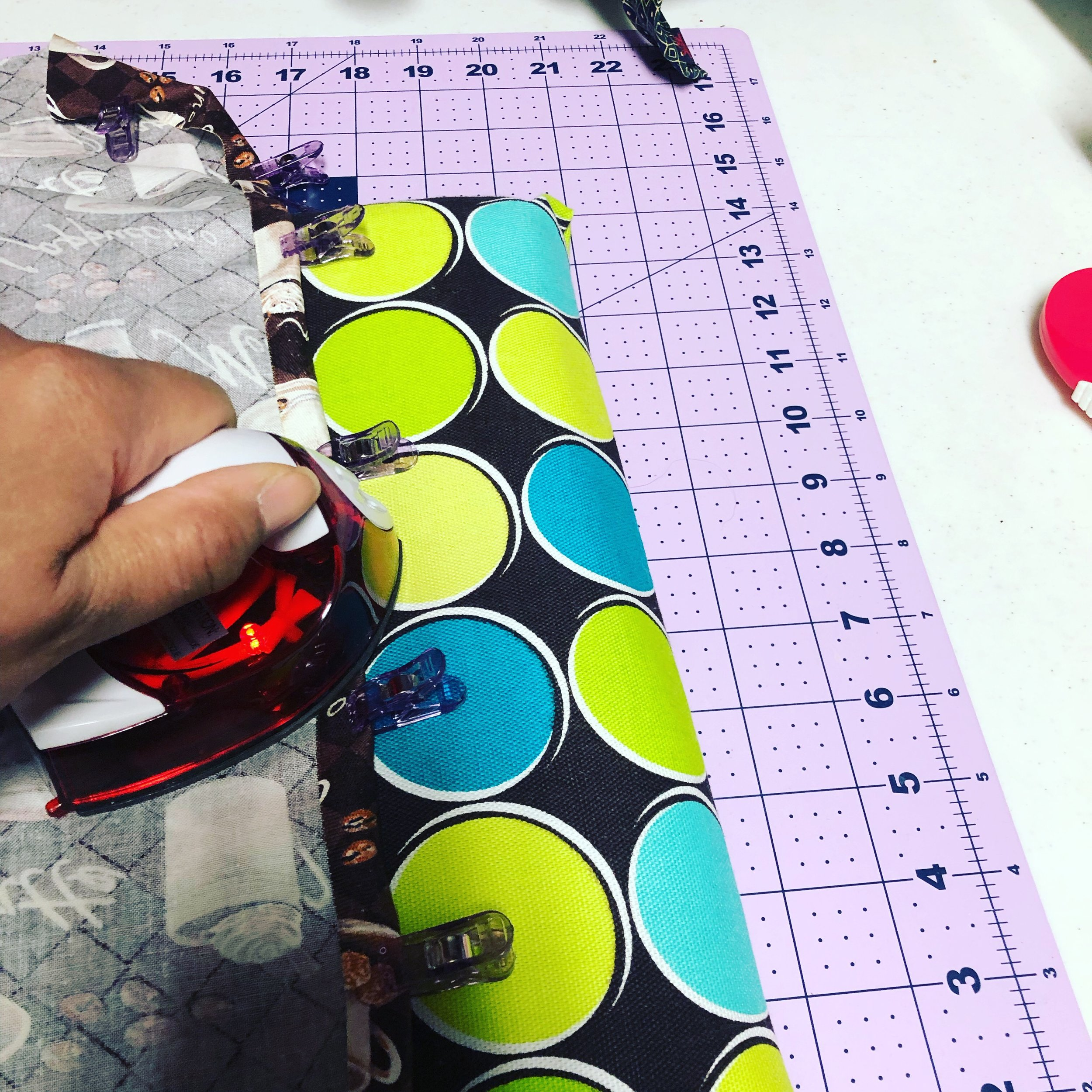 This is my pressing board and travel iron that I use in my sewing room, they help me do quick presses and their portable in case I go to a craft retreat.