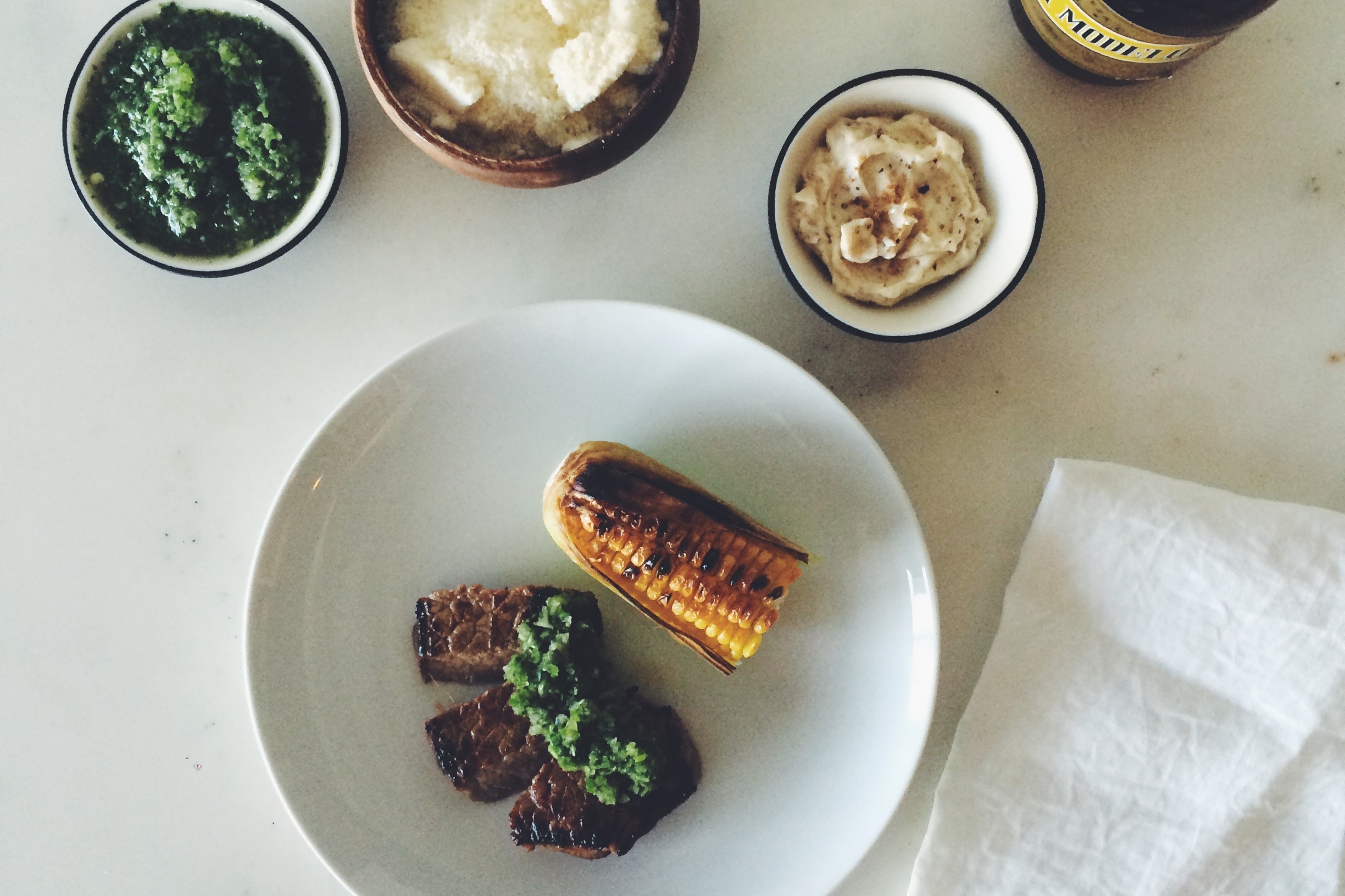 OBELO | Beer-Marinated Flank Steak with Aji Salsa and Grilled Corn