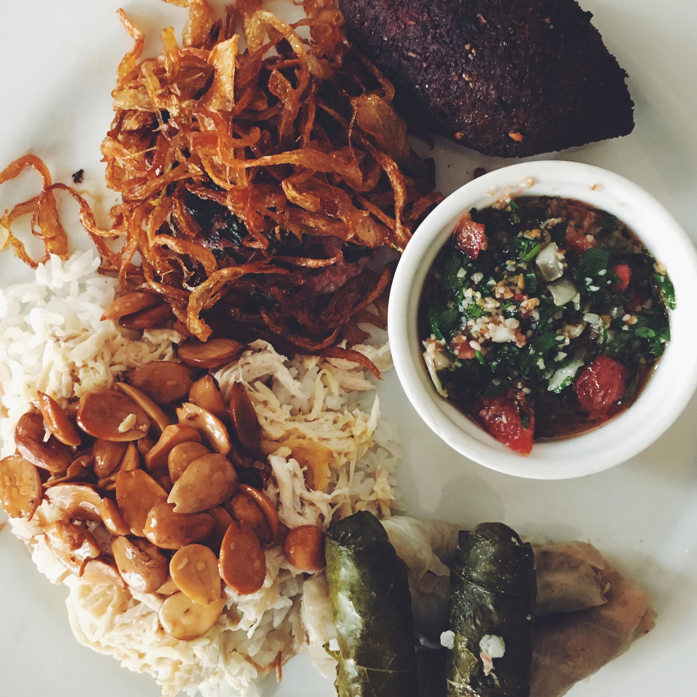 Arab Platter,  Bandeja Árabe , marcona almond rice, fried  kibbe  with onions, tabouleh and warm grape leaves.