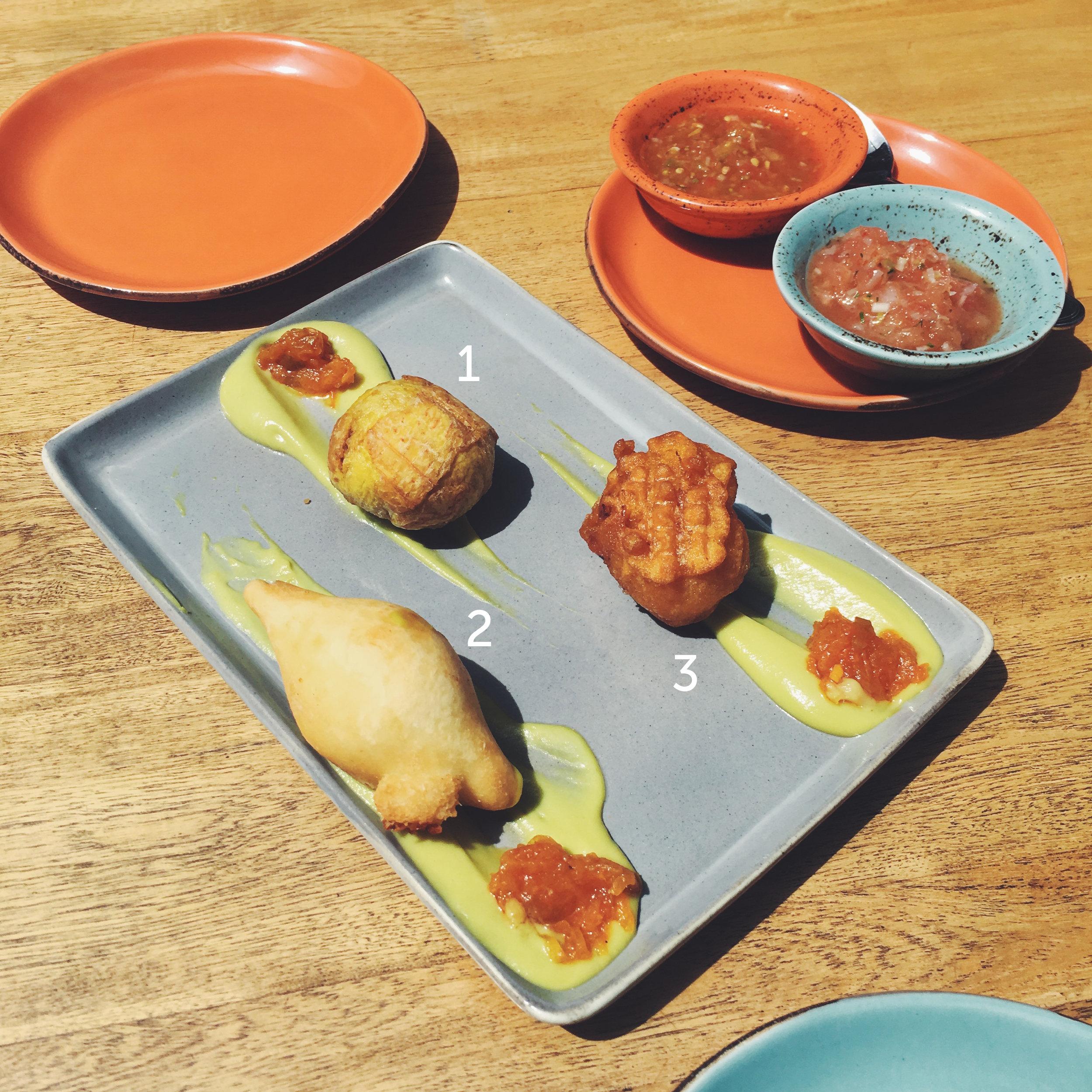 Surtido de Fritos  served with avocado cream,  hogao  and sweet and savory ají