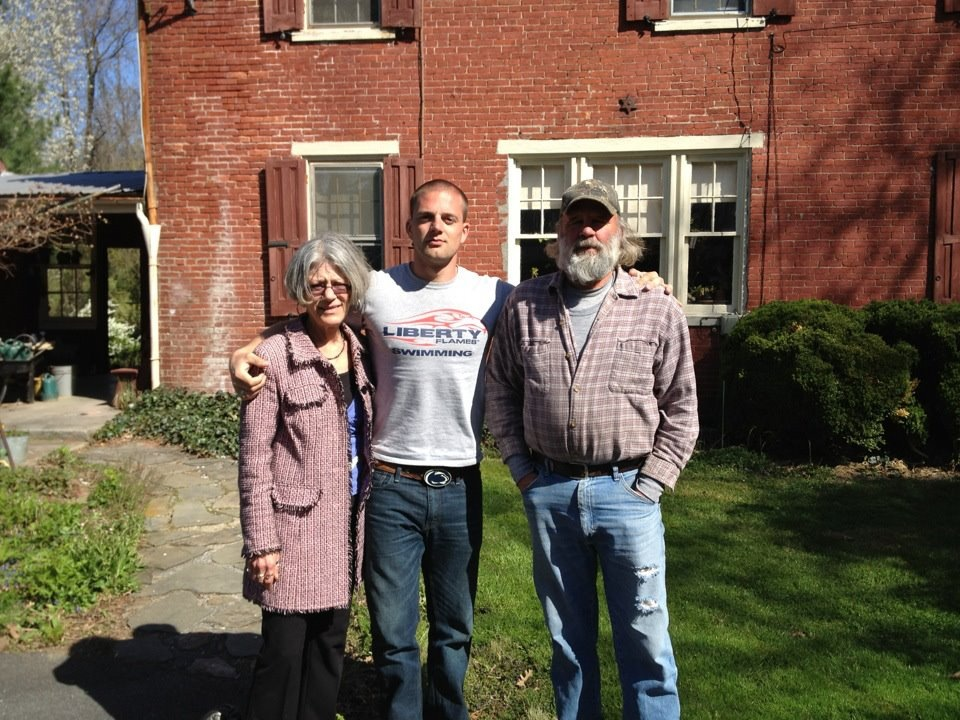Mom, Dad, and I in front of the farmhouse, built in 1859 by Jacob Shellenberger