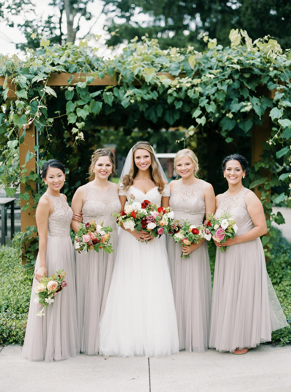 bridesmaid-bouquets-at-wells-barn.jpg