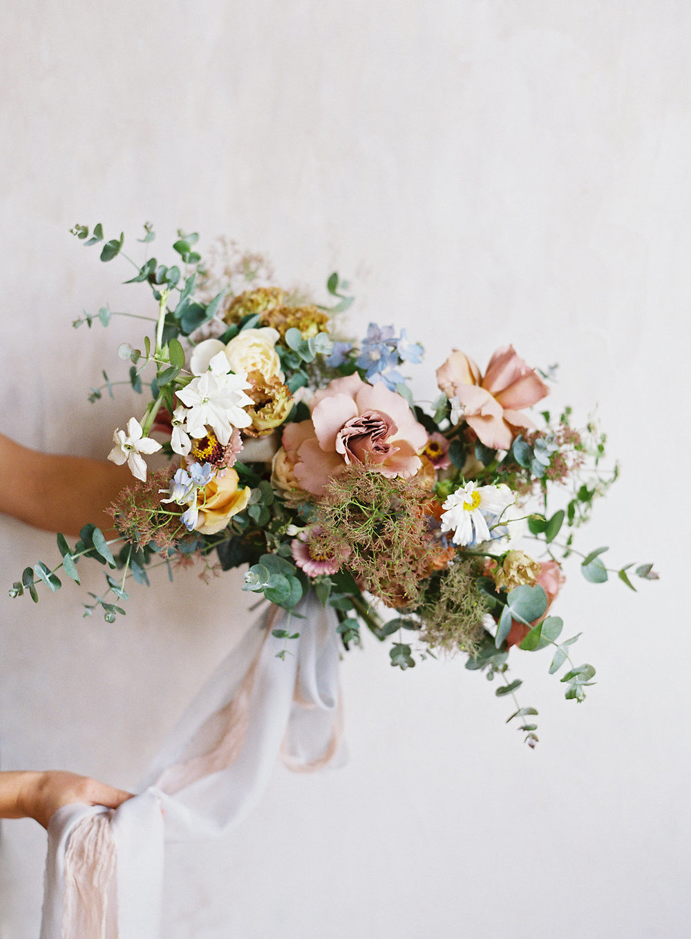 textured-bridal-bouquet-with-ribbons.jpg