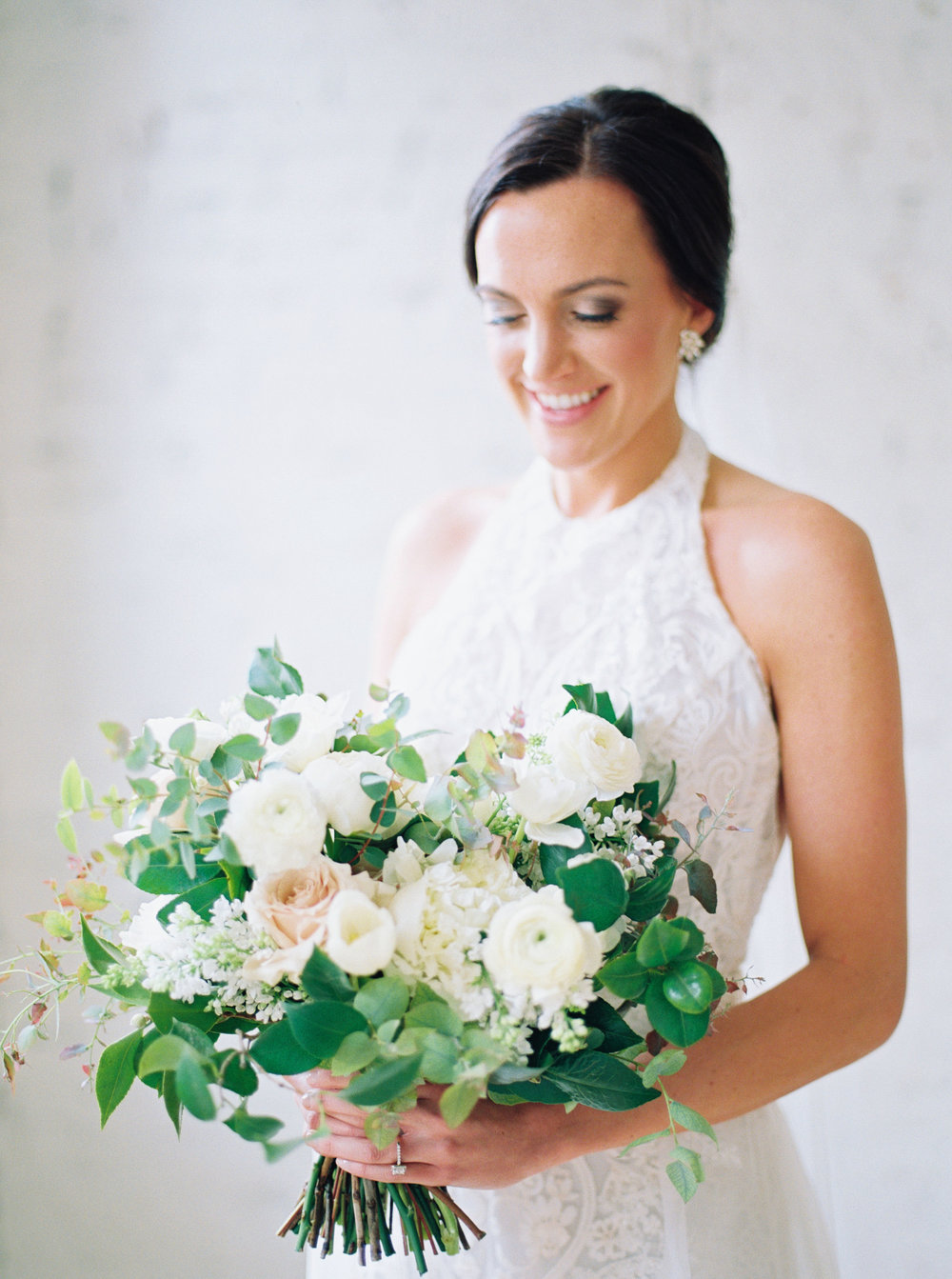 white-studio-bridal-portrait-flowers.jpg