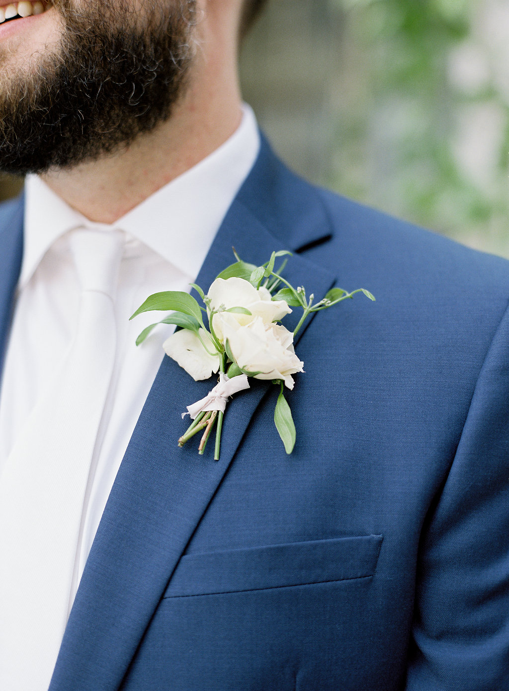 groom-simple-white-boutonniere-strongwater.jpg