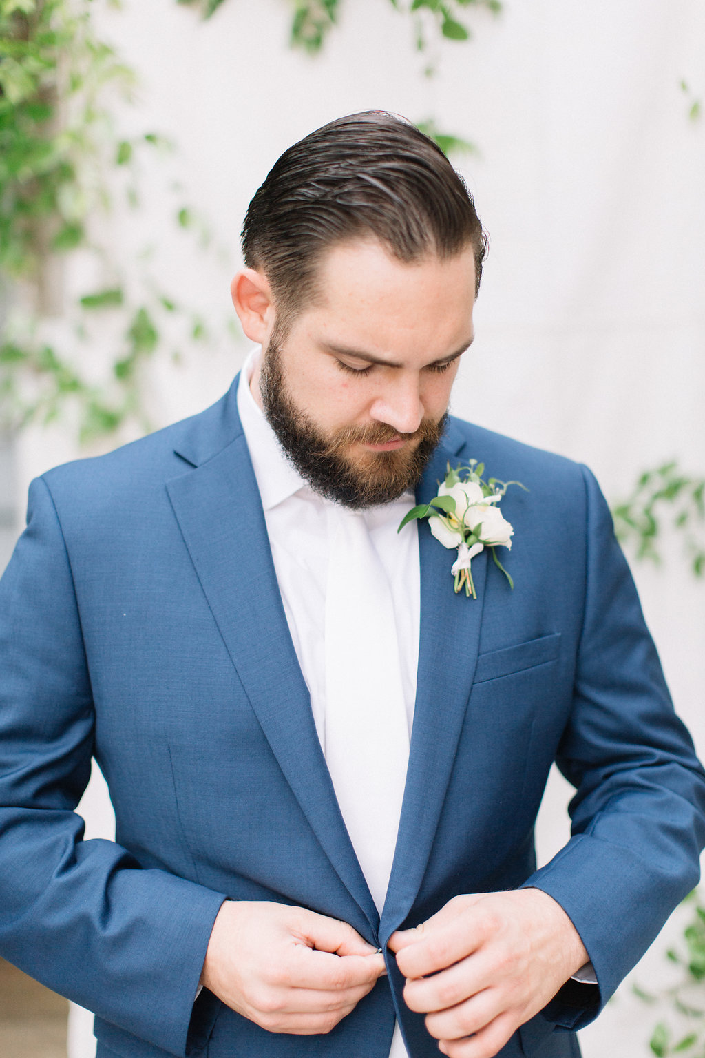 white-and-greenery-boutonniere.jpg