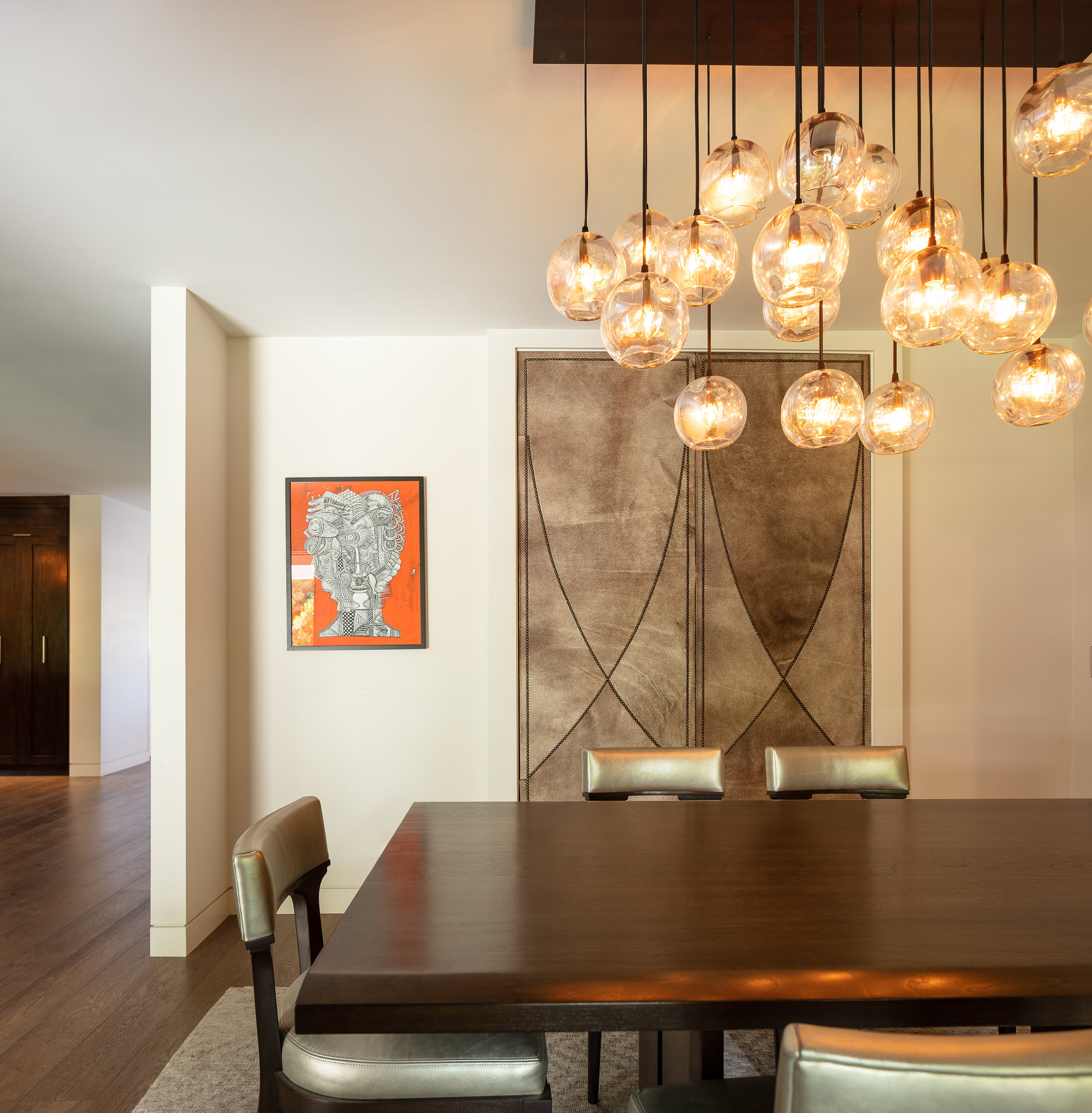 DINING ROOM WITH TOUCH LATCH HAIR-ON-HIDE DOORS TO EXTRA STORAGE AREA