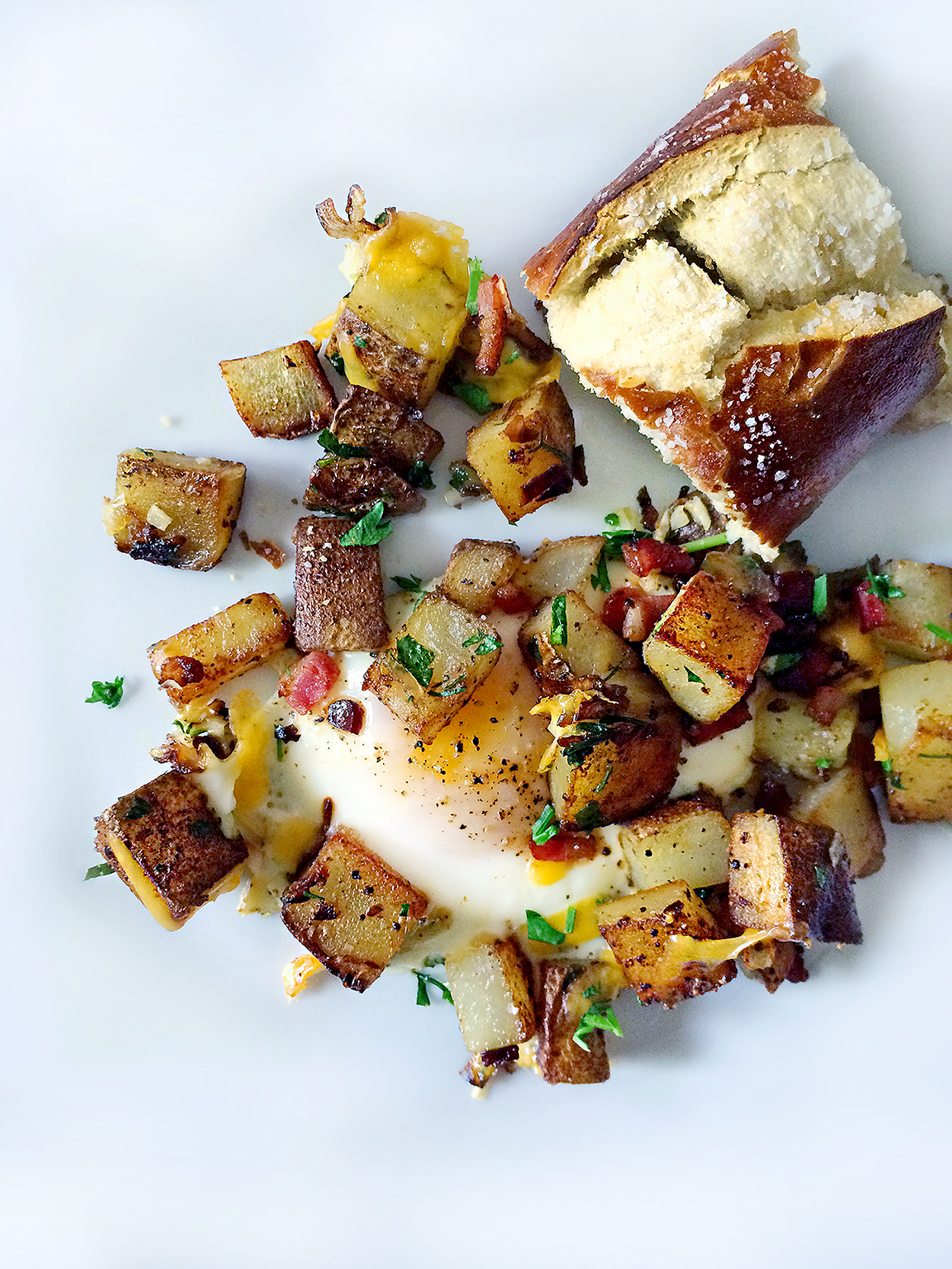 Breakfast potatoes with Pancetta, Eggs and Pretzel Bread.