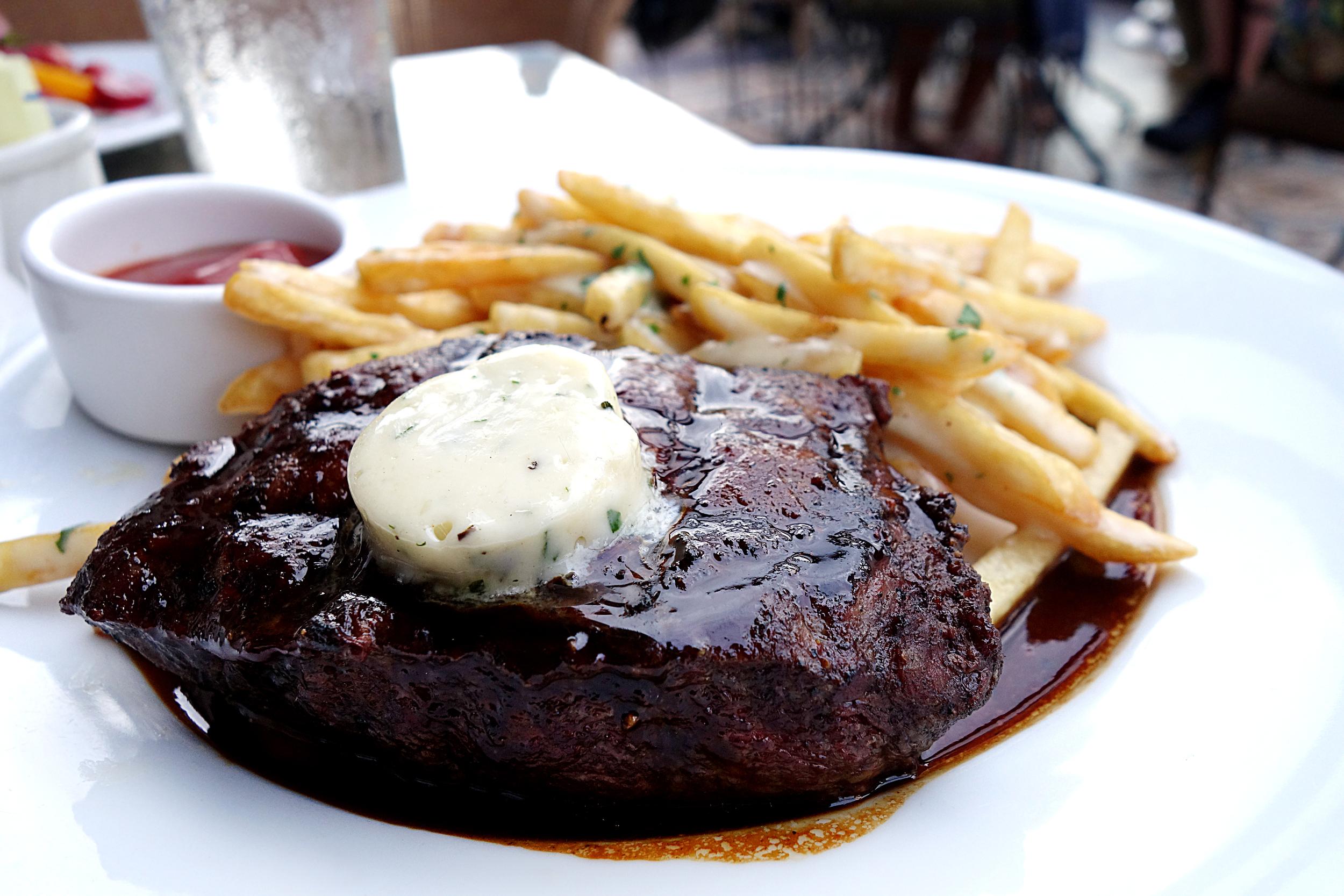 "Steak Frites $26 (""'flat iron, maitre d' butter, bordelaise, truffle cheese fries"")"