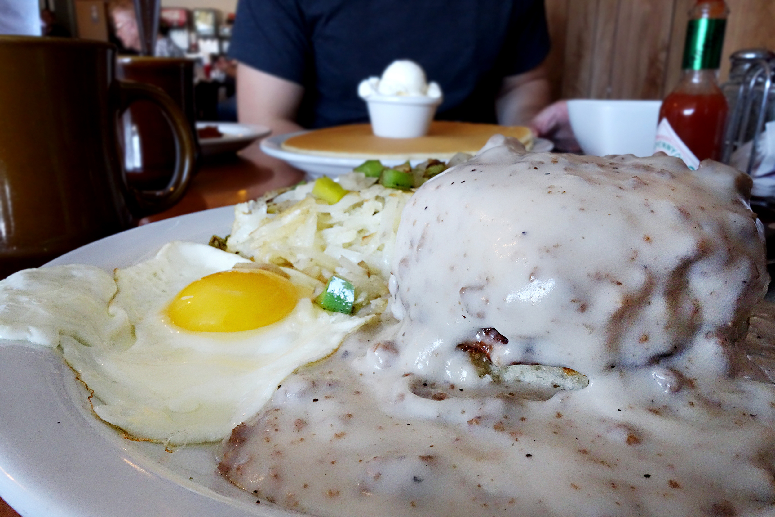 Pop's Country Breakfast: Sausage Biscuit and Sausage Gravy. Served with Irish potatoes and egg.