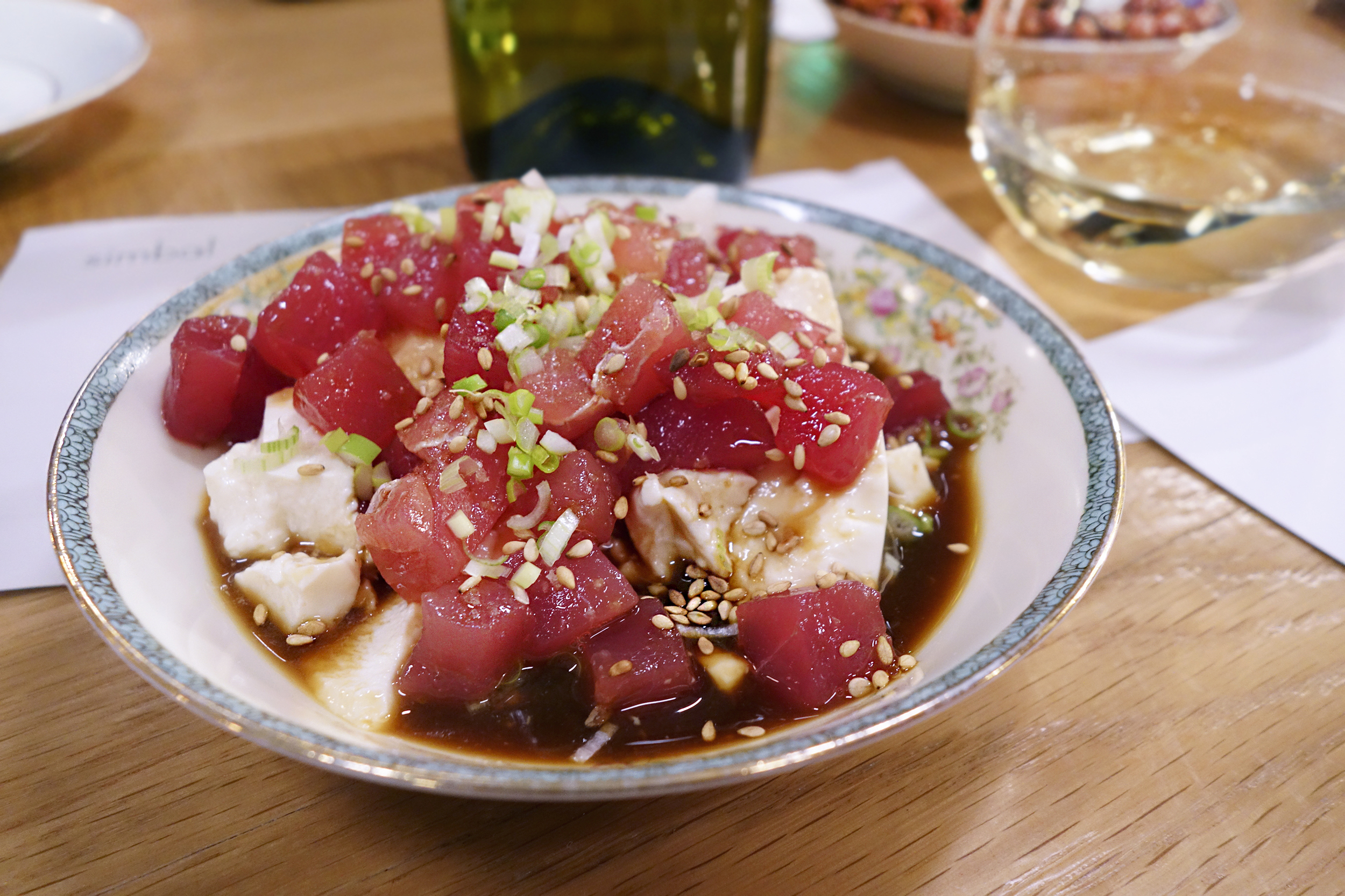 Fresh Meiji tofu, tuna, ponzu, sesame seeds, scallions