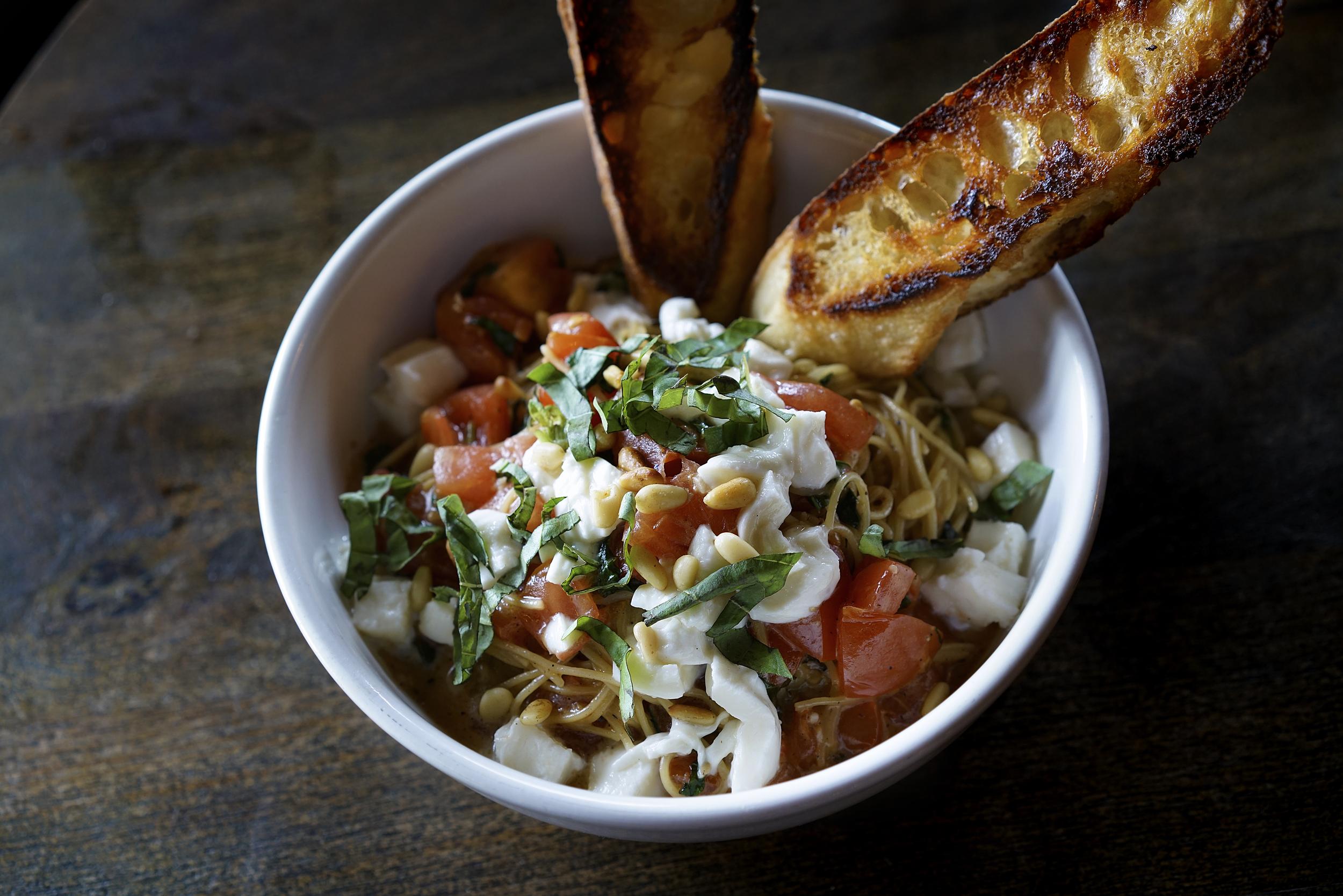 Angel Hair Pasta with Fresh Tomatoes, Basil, Mozzarella & Pine nuts