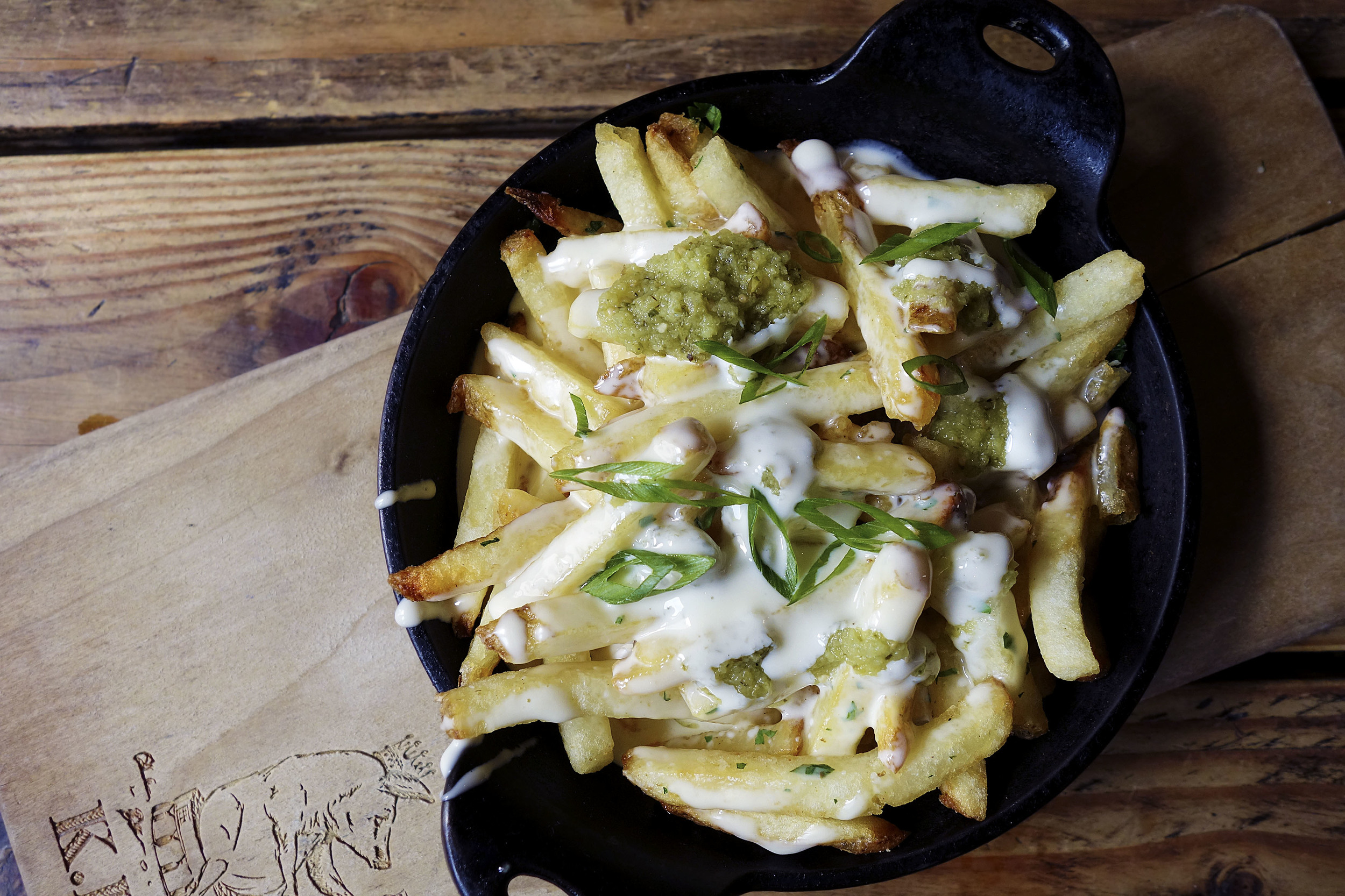 Fries with Cheese whiz and spicy verde