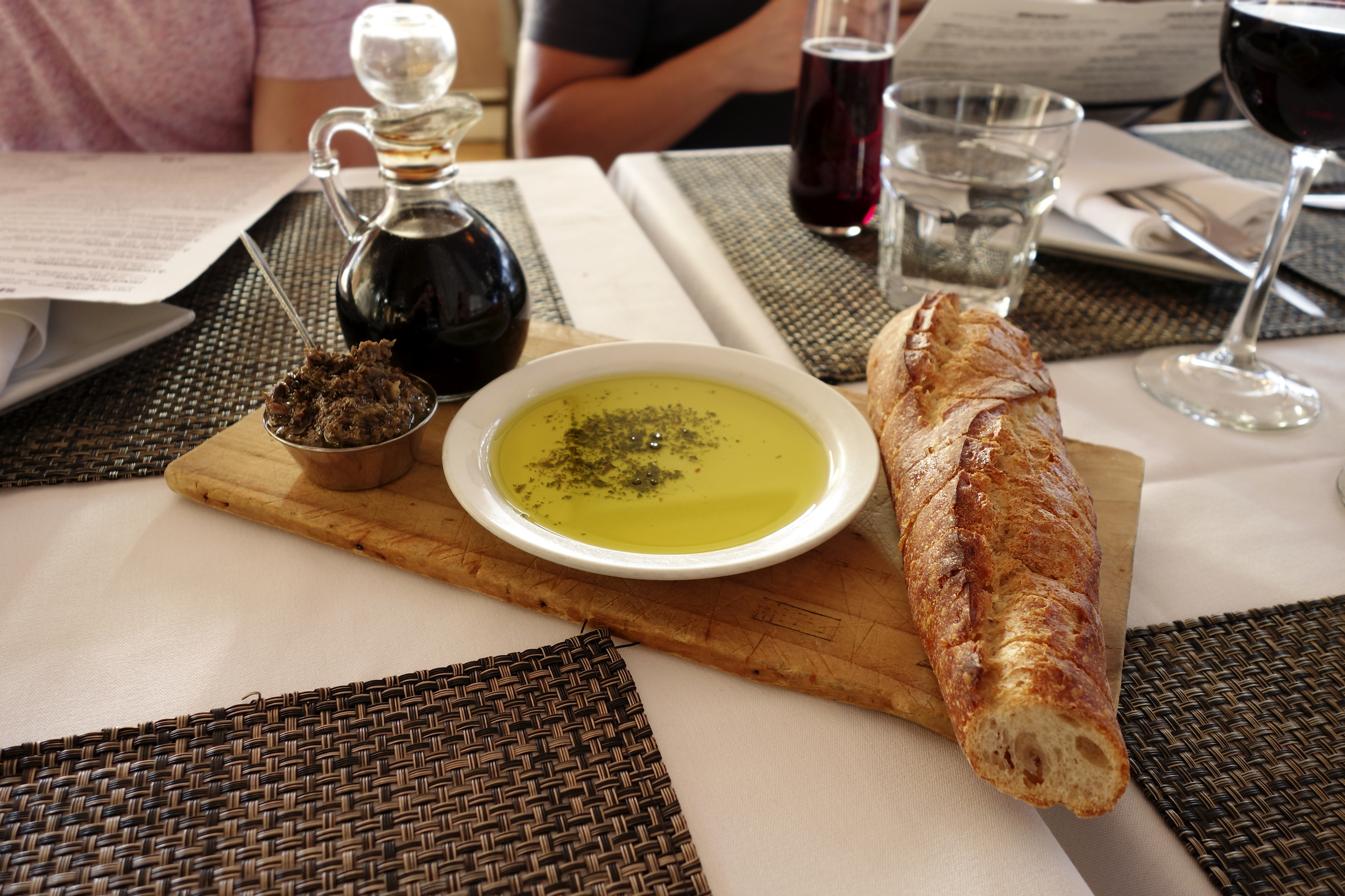 Bread, herb olive oil & balsamic, and olive tapenade.