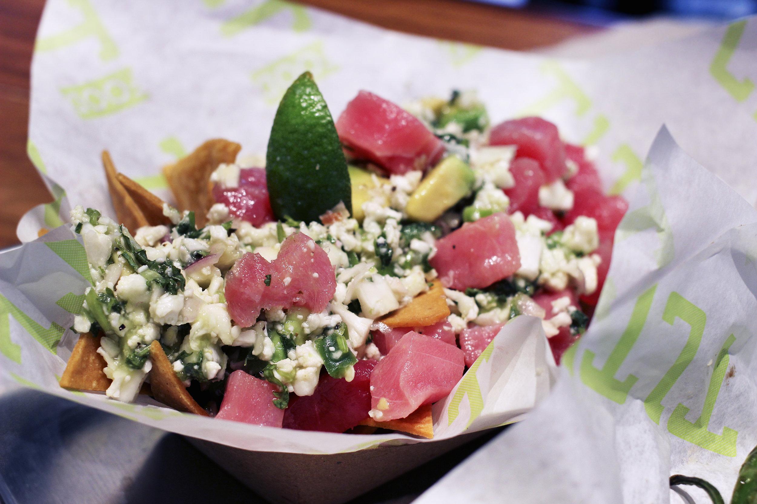 Cali Ceviche -Cauliflower, Avocado, Lime, Red Onion, Cilantro, Jalapeño, Corn Tortilla Chips. Additional charge to add tuna.