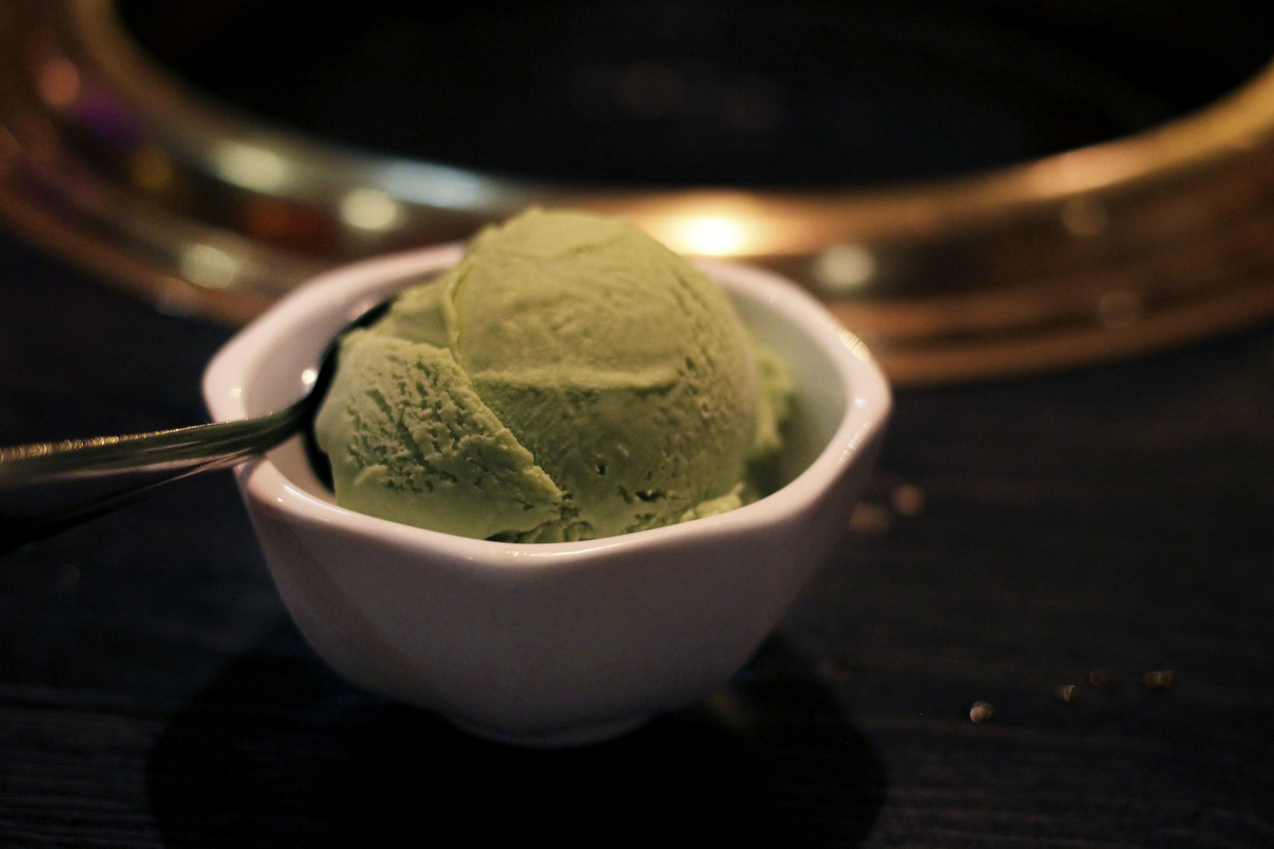 Green tea Ice cream - A generous scoop. Strong matcha flavor. Served with a hot cup of Houjicha (roasted sencha).