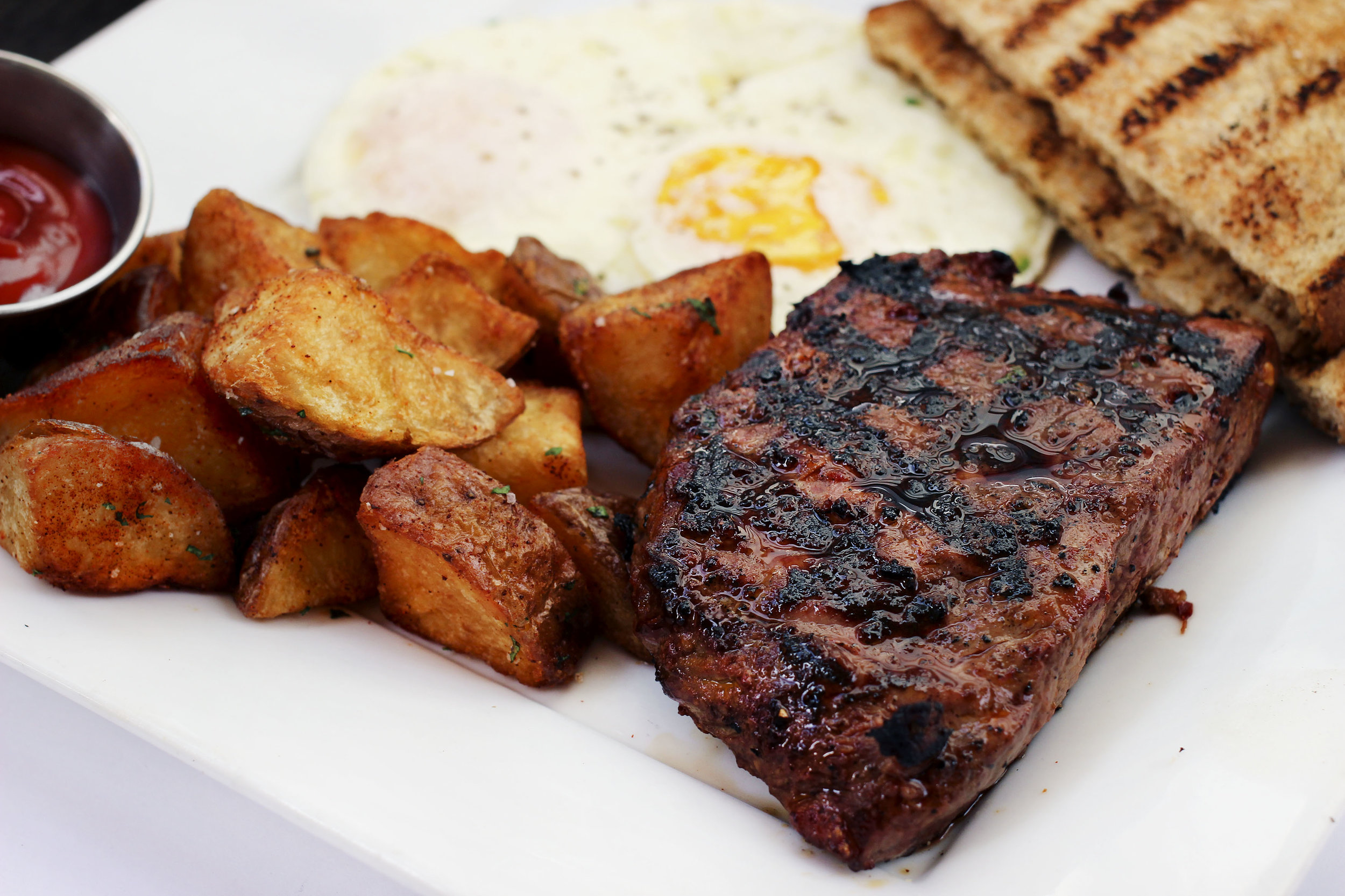 Flatiron Steak, roasted potatoes, eggs, and toast. The flatiron was cooked perfectly, extremely tender, ridiculously juicy.