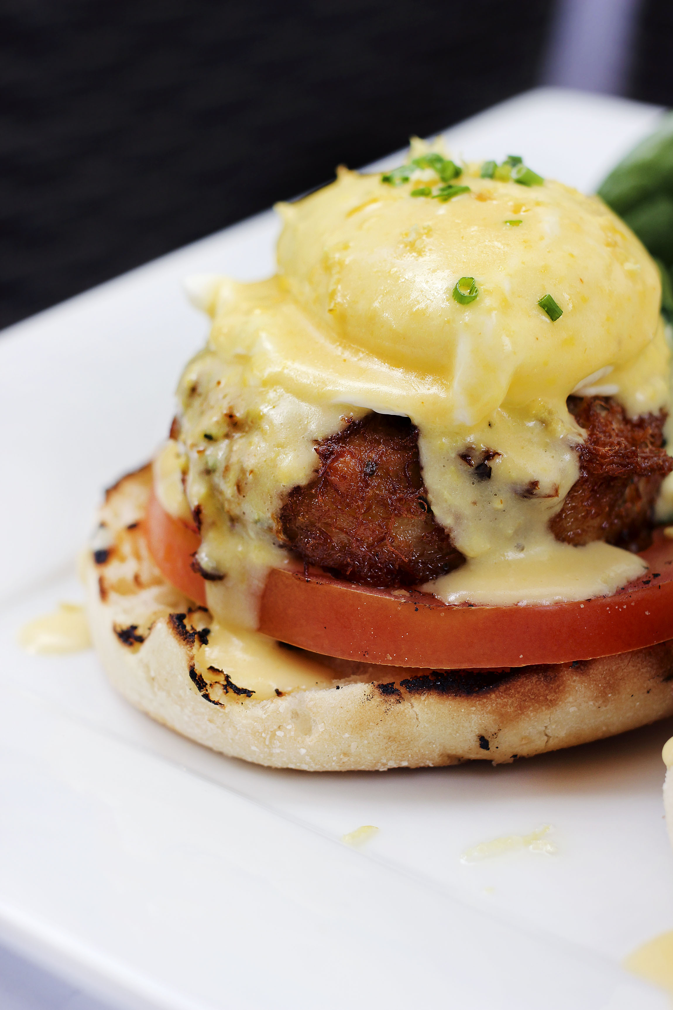 CRAB CAKE BENEDICT - Loaded Crab Cake, grilled tomato, poached eggs, English muffin, and topped with a lemon hollandaise sauce. What I couldn't get over was the lemon hollandaise. Such a slight citrus touch, but made the dish very bright.