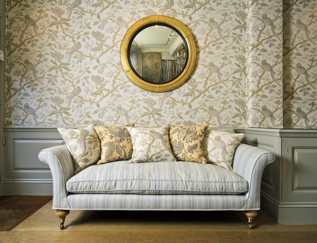 Cherry Tree Blue (walls), Tatting Stripe (sofa), Cherry Tree (pillows), Banyan Charcoal Blue on Beige(pillows)
