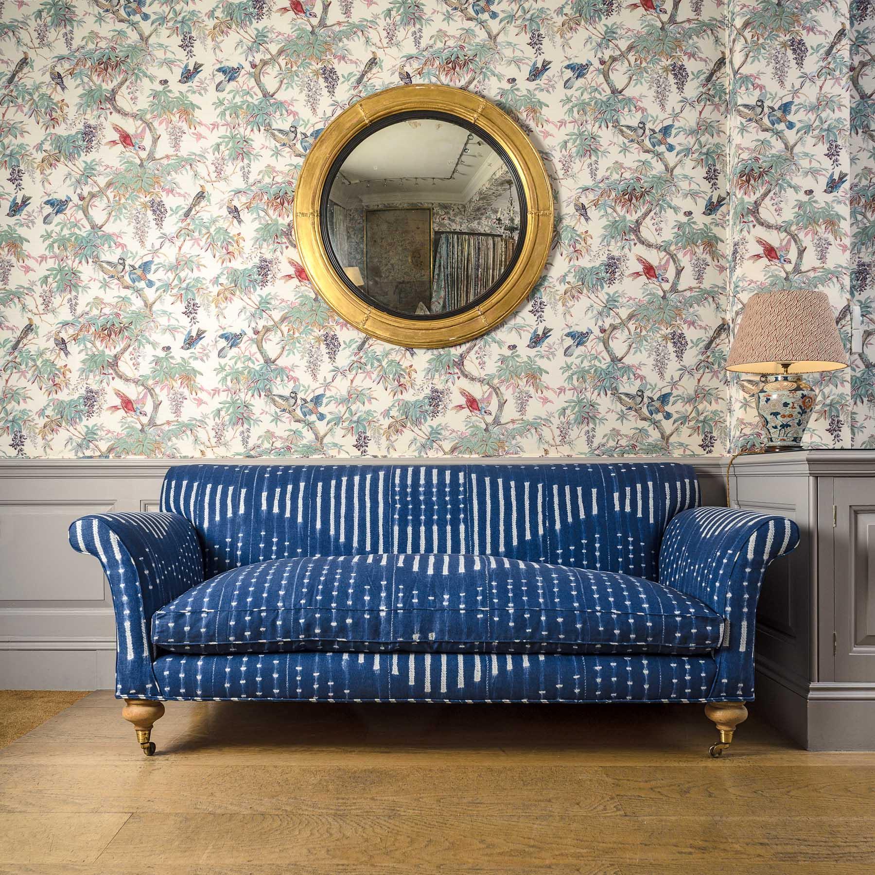 Onikoko Indigo upholstered Bollington Sofa and Paradise Original on Oyster walling