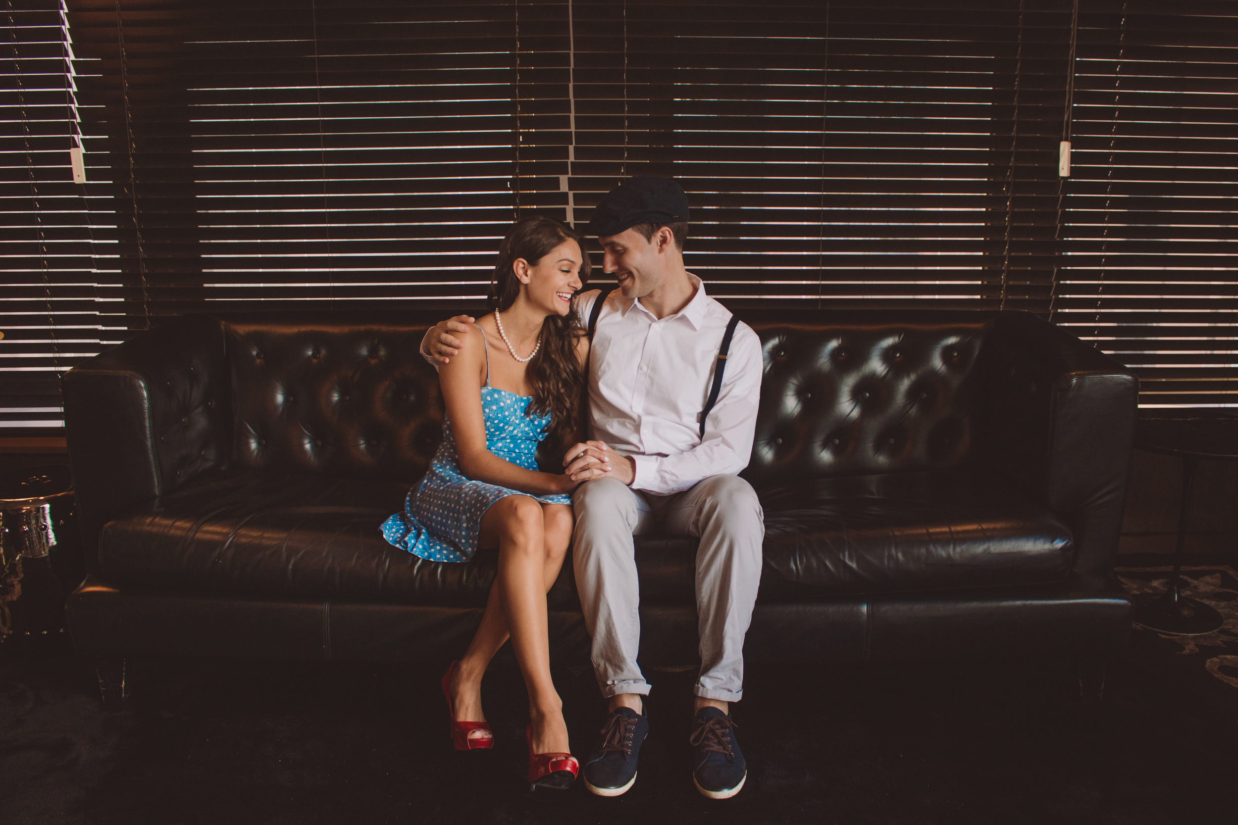 vintage inspired couple sitting on couch