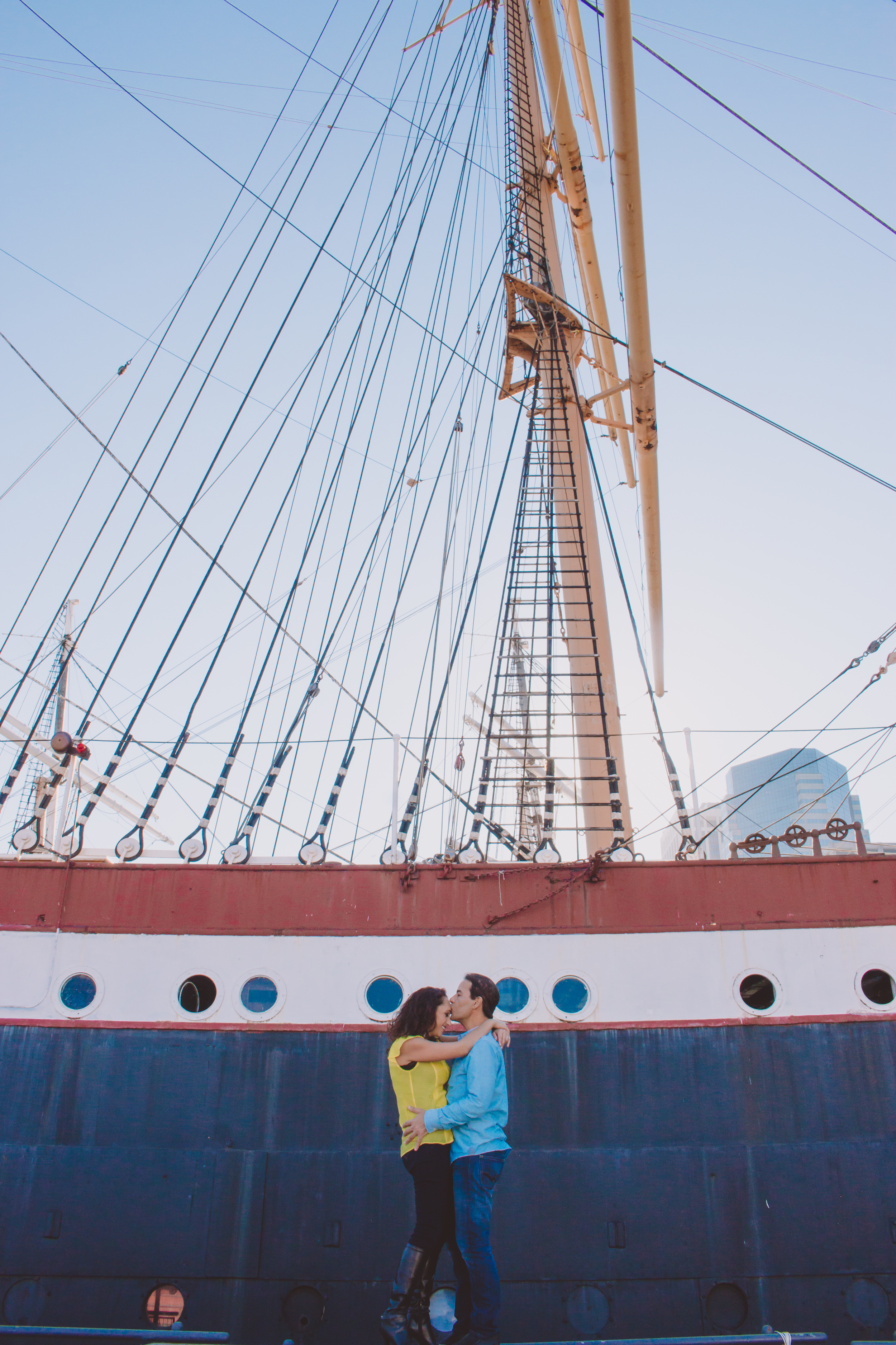Engagement photos near large ship