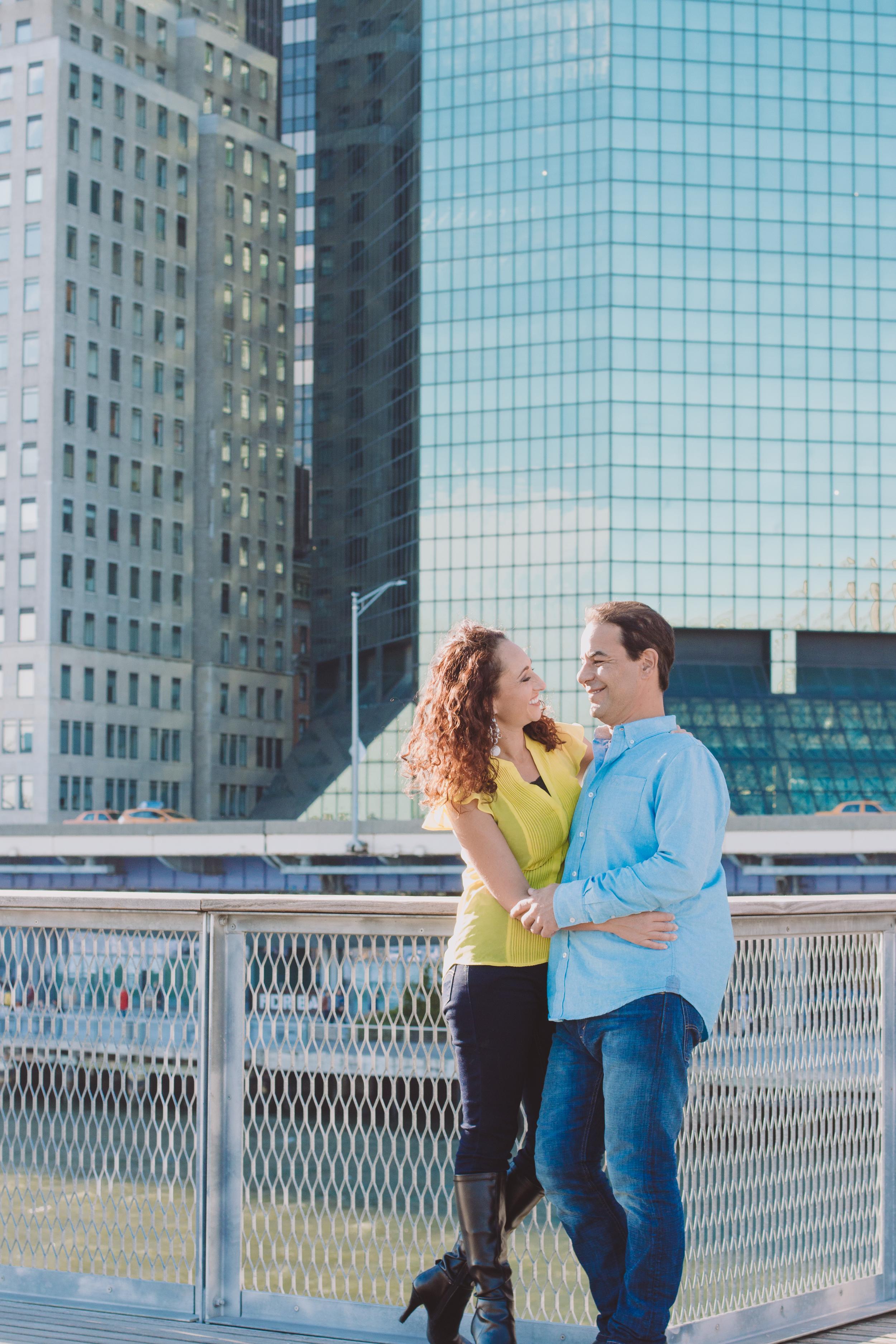 blue buildings skyline nyc couple engaged