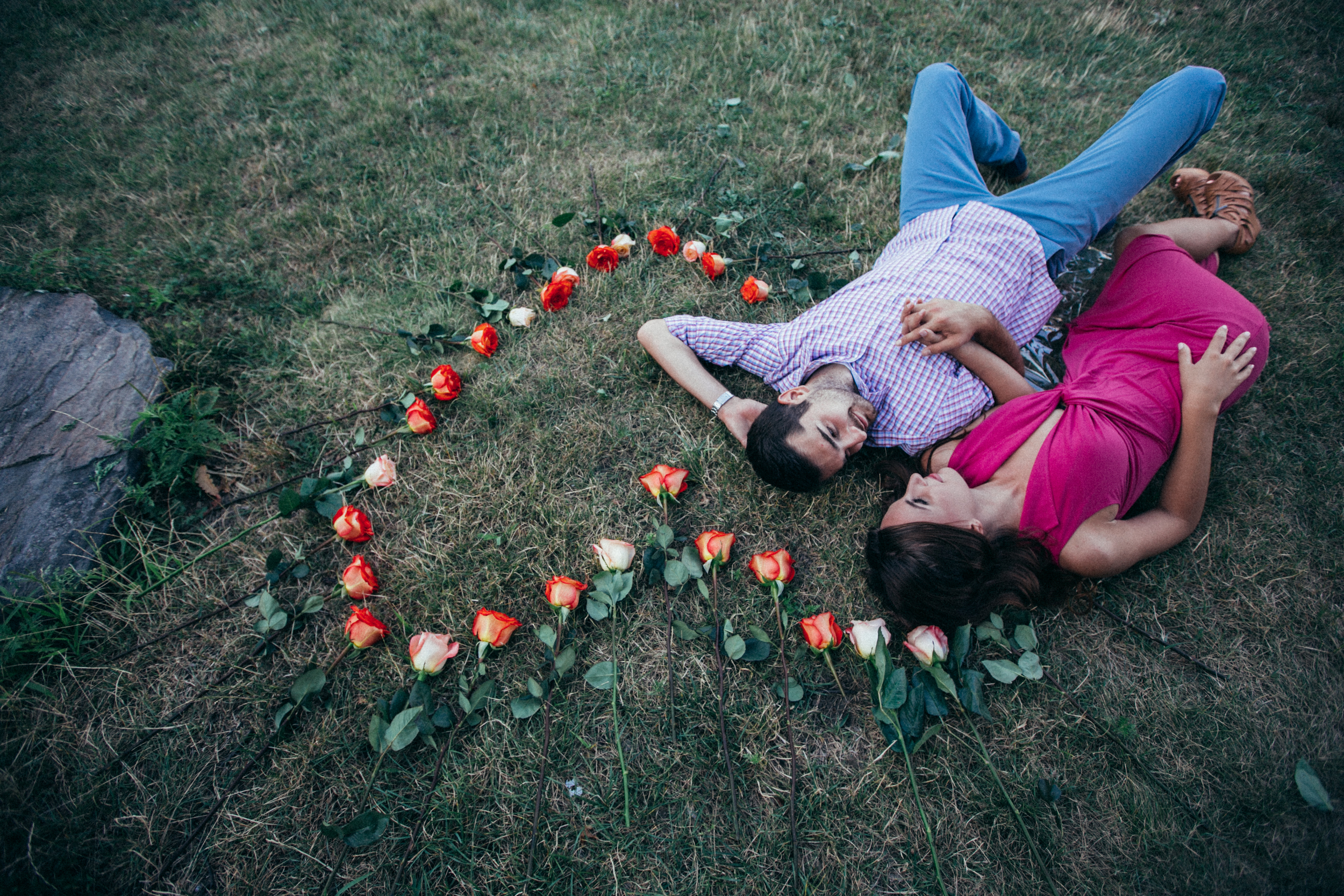 Couple laying in heart shaped flowers