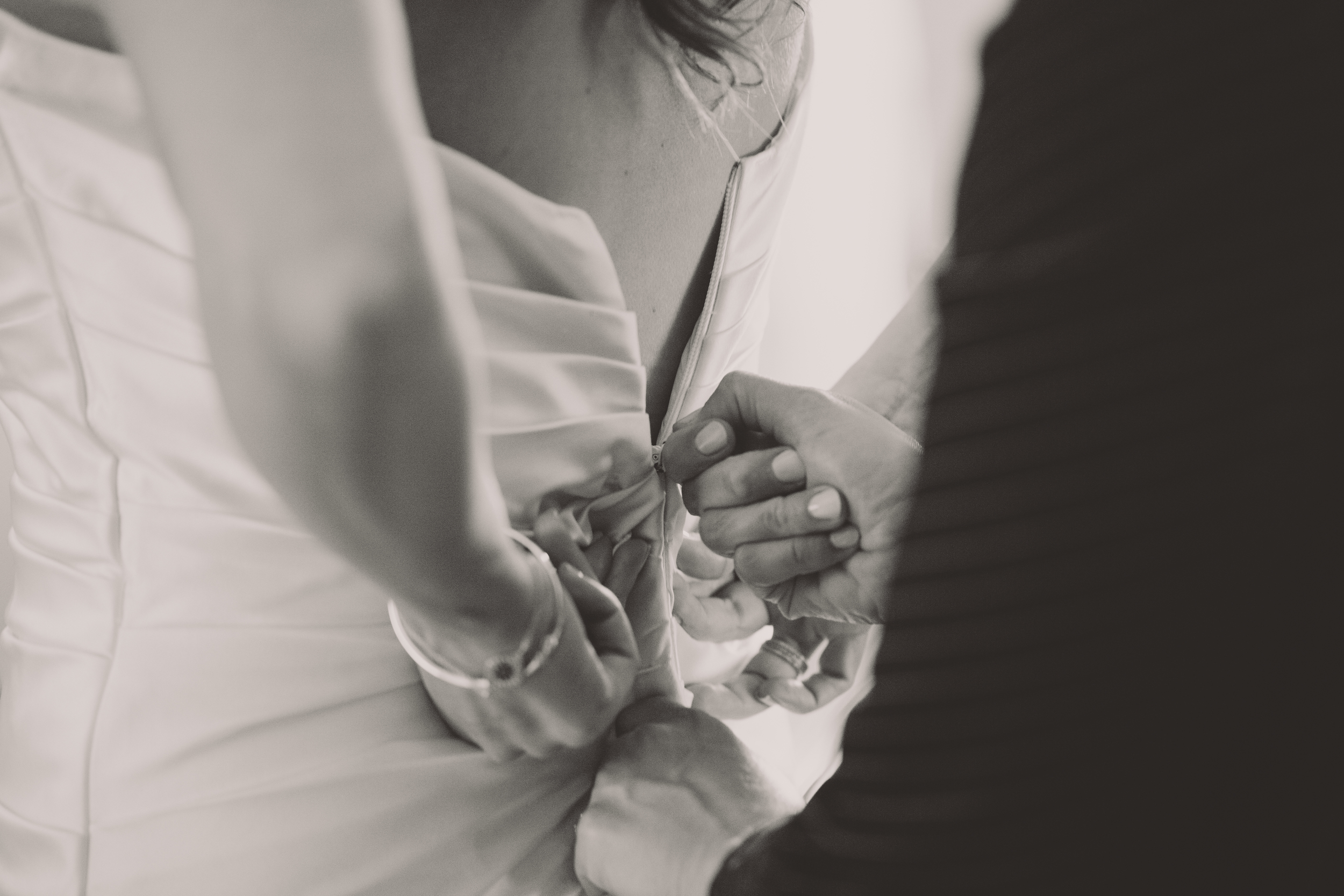 zipping up the dress