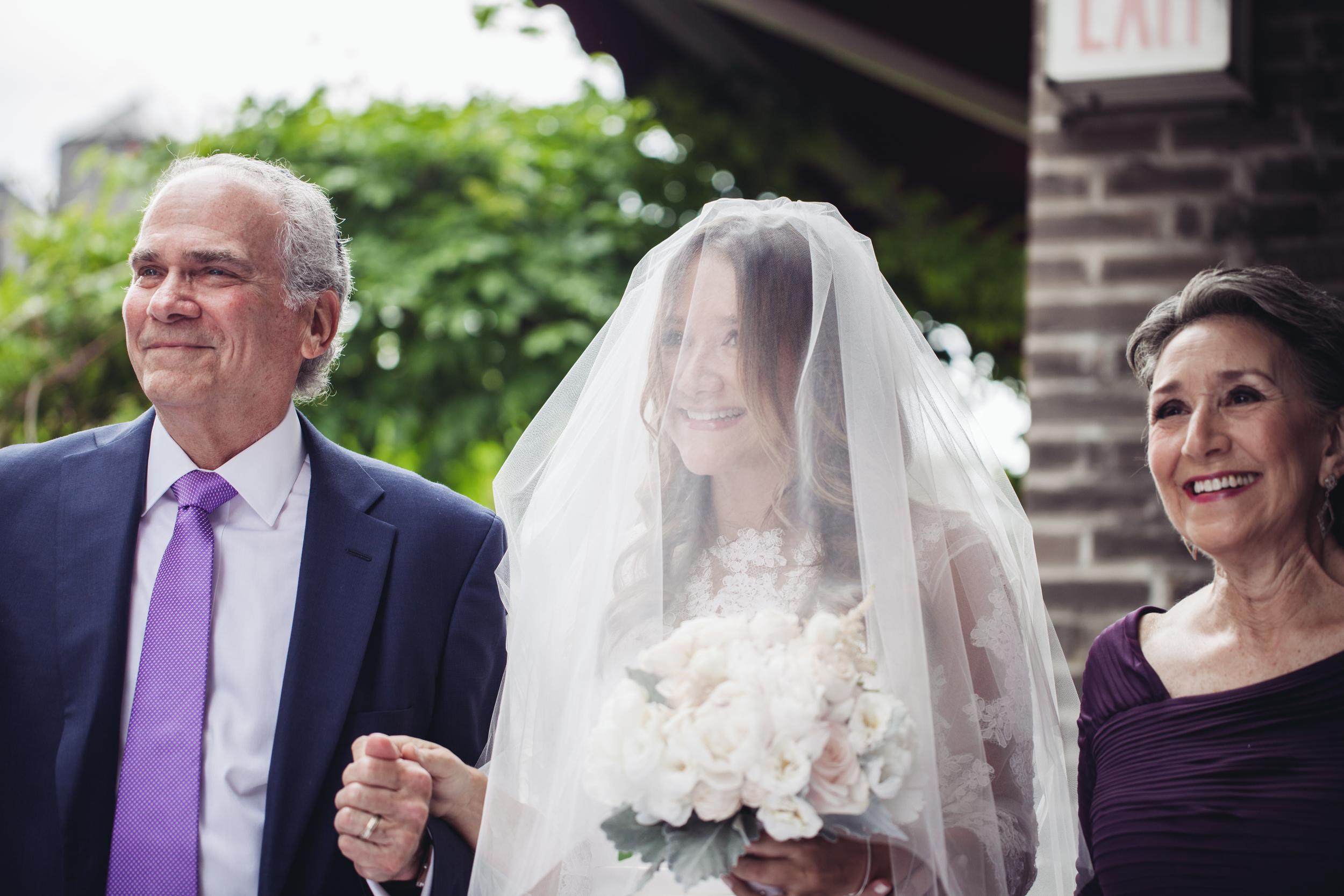 parents walking bride