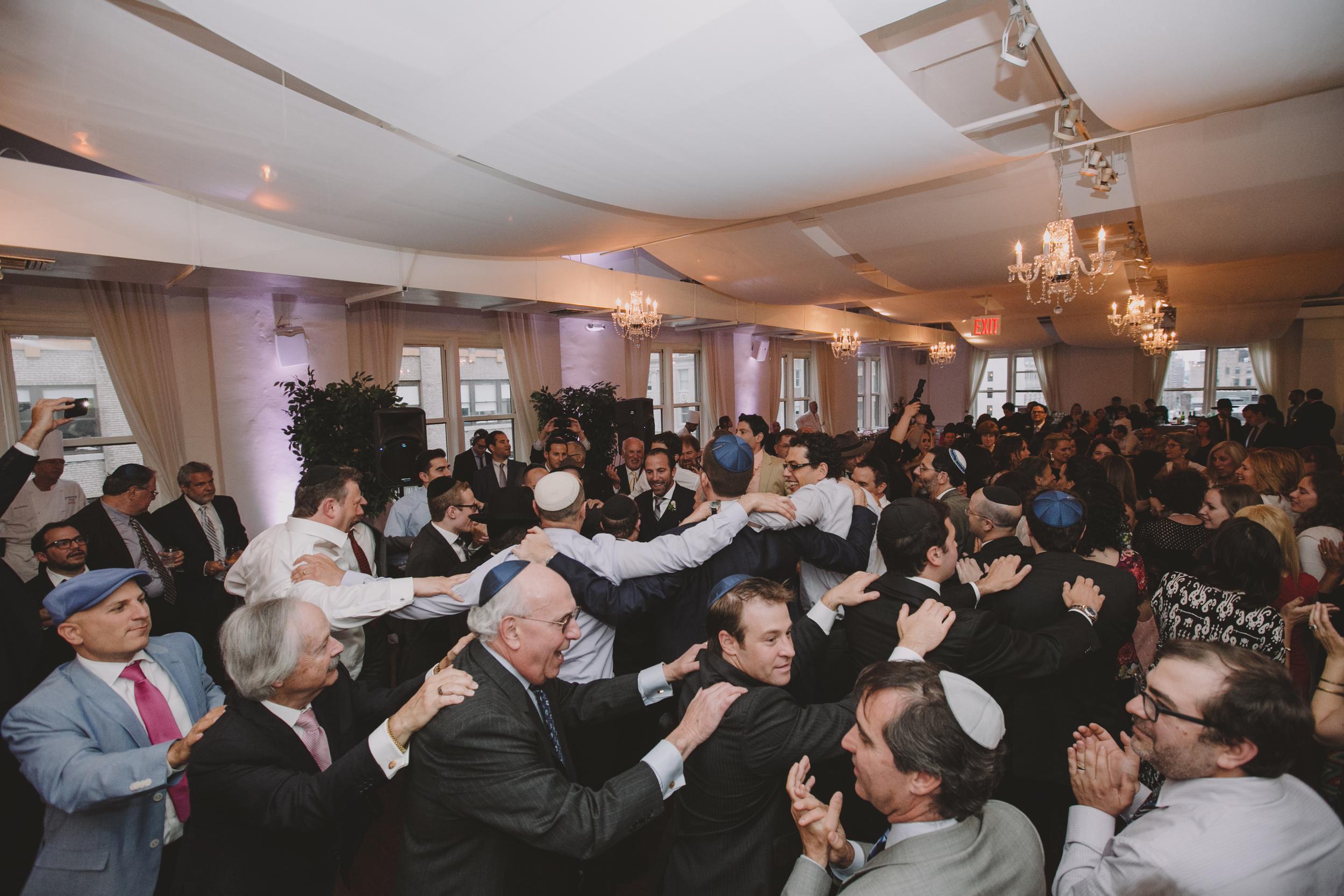 men dancing jewish wedding