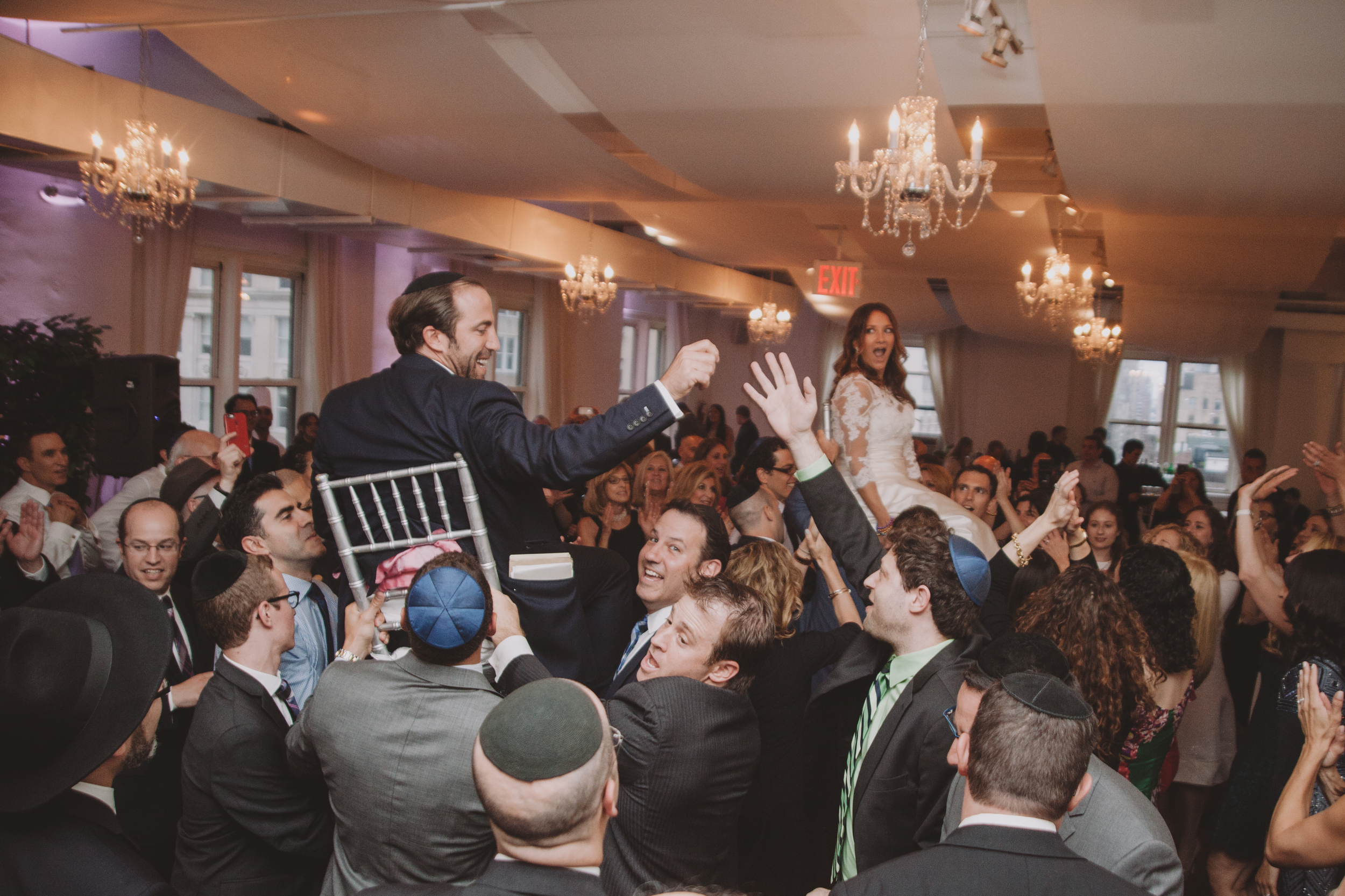 groom and bride on chairs