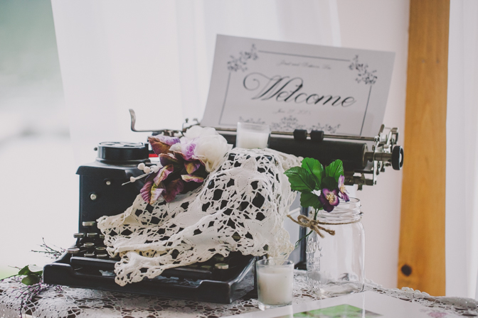 typewriter prop at lakehouse wedding DIY by bridge and groom