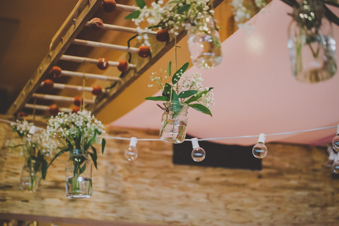 hanging flowers in mason jars as wedding decor