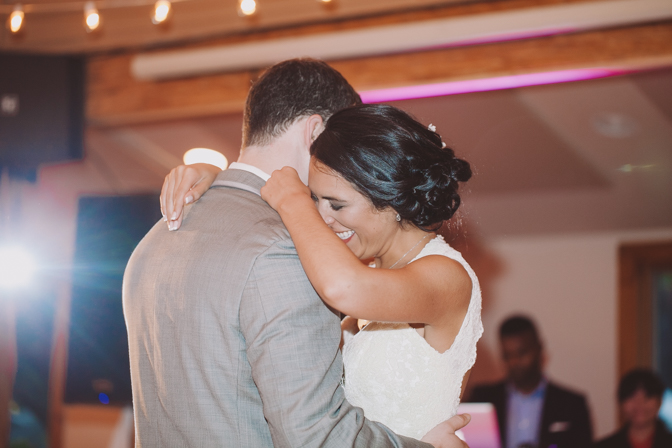 bride and groom have their first dance together