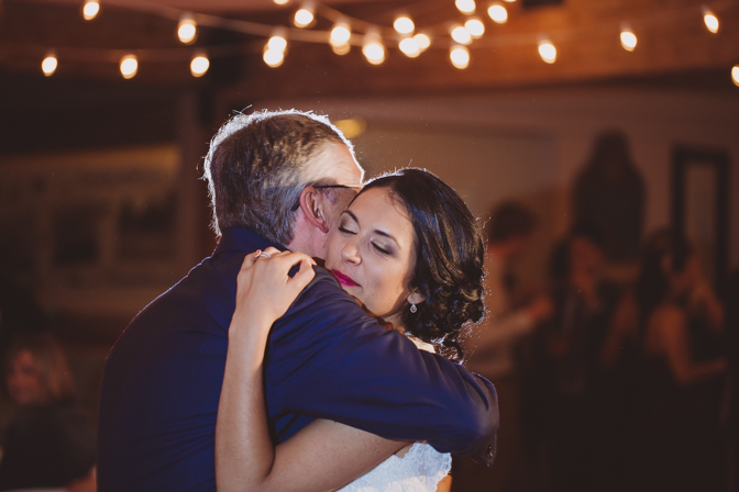 father daughter dance inside of farm lakehouse wedding