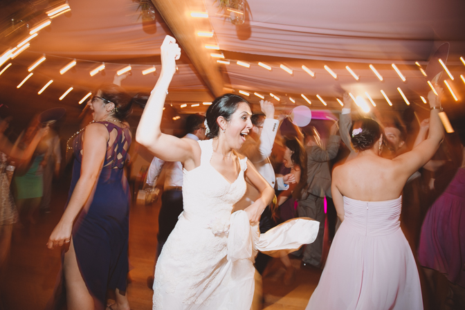 fun long exposure photo of bride dancing at her wedding