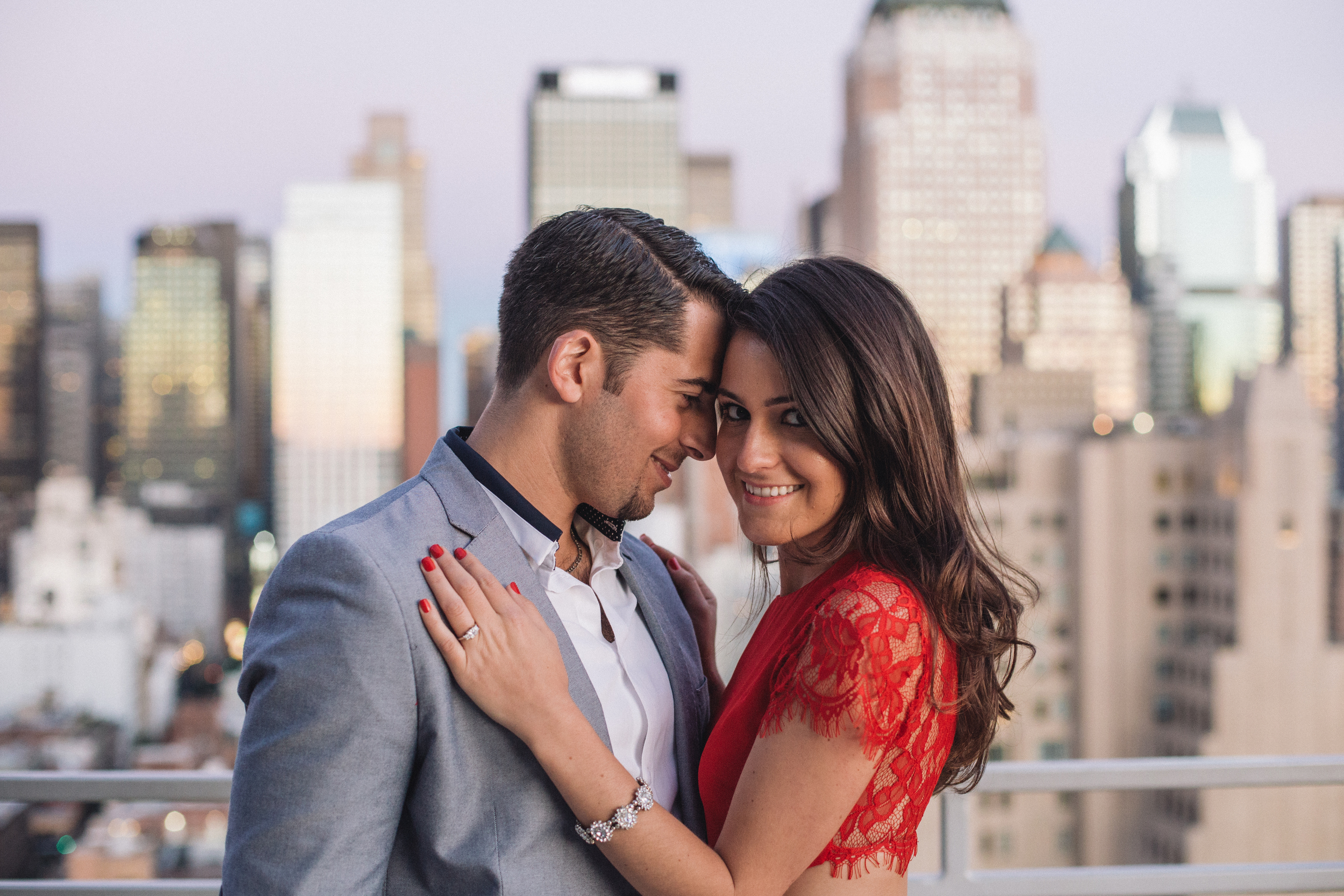 beautiful sunset on nyc rooftop with couple