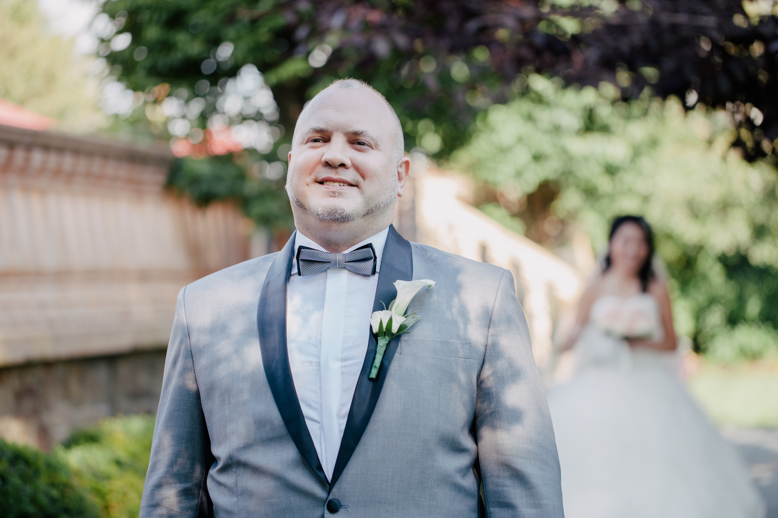groom waiting to see his bride for their first look
