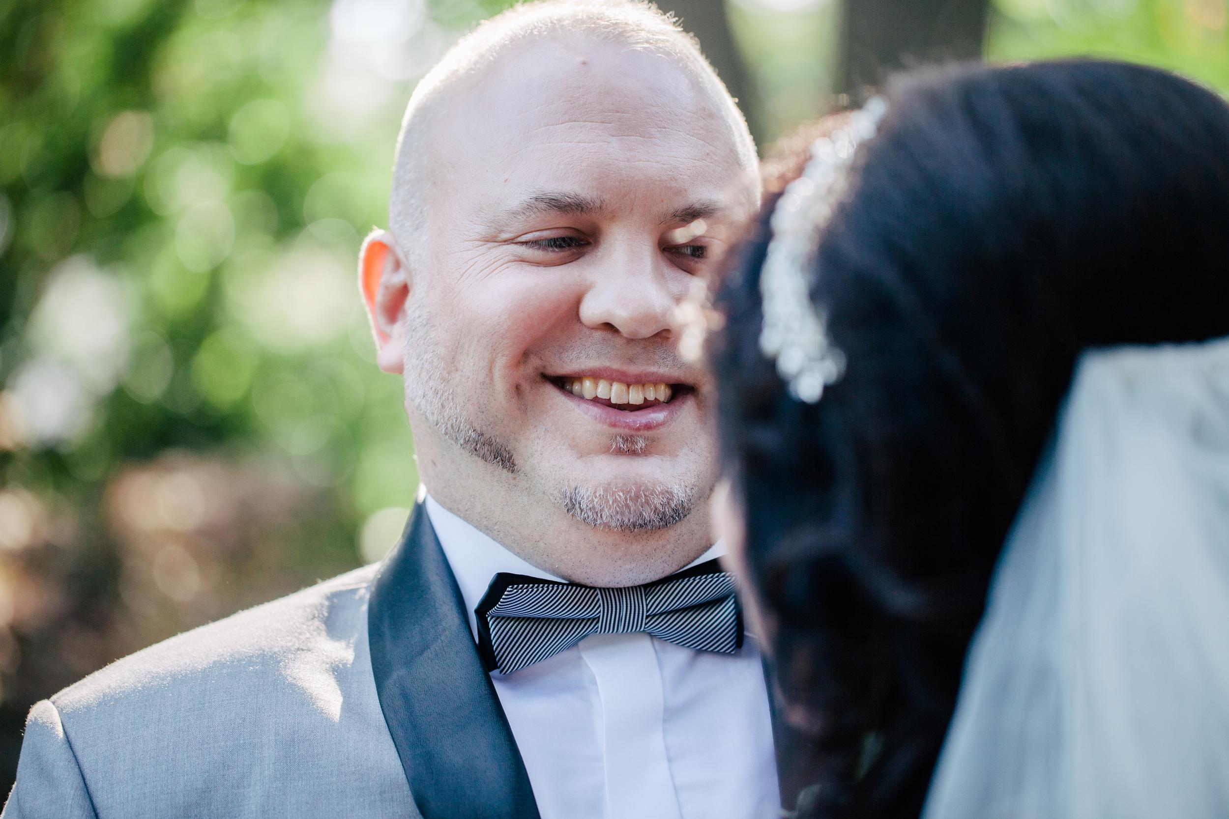 emotional look of groom on his wedding day