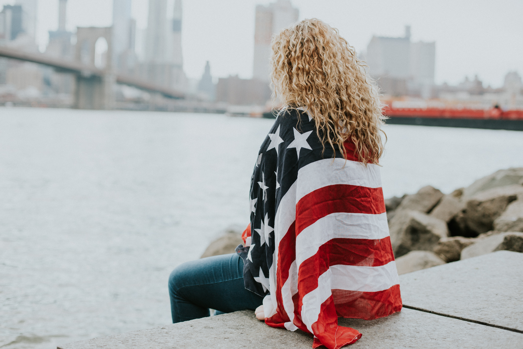 blonde girl with American flag nyc