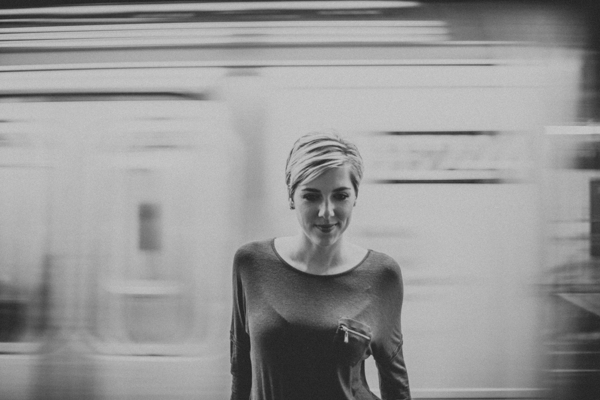 girl in front of moving subway photography