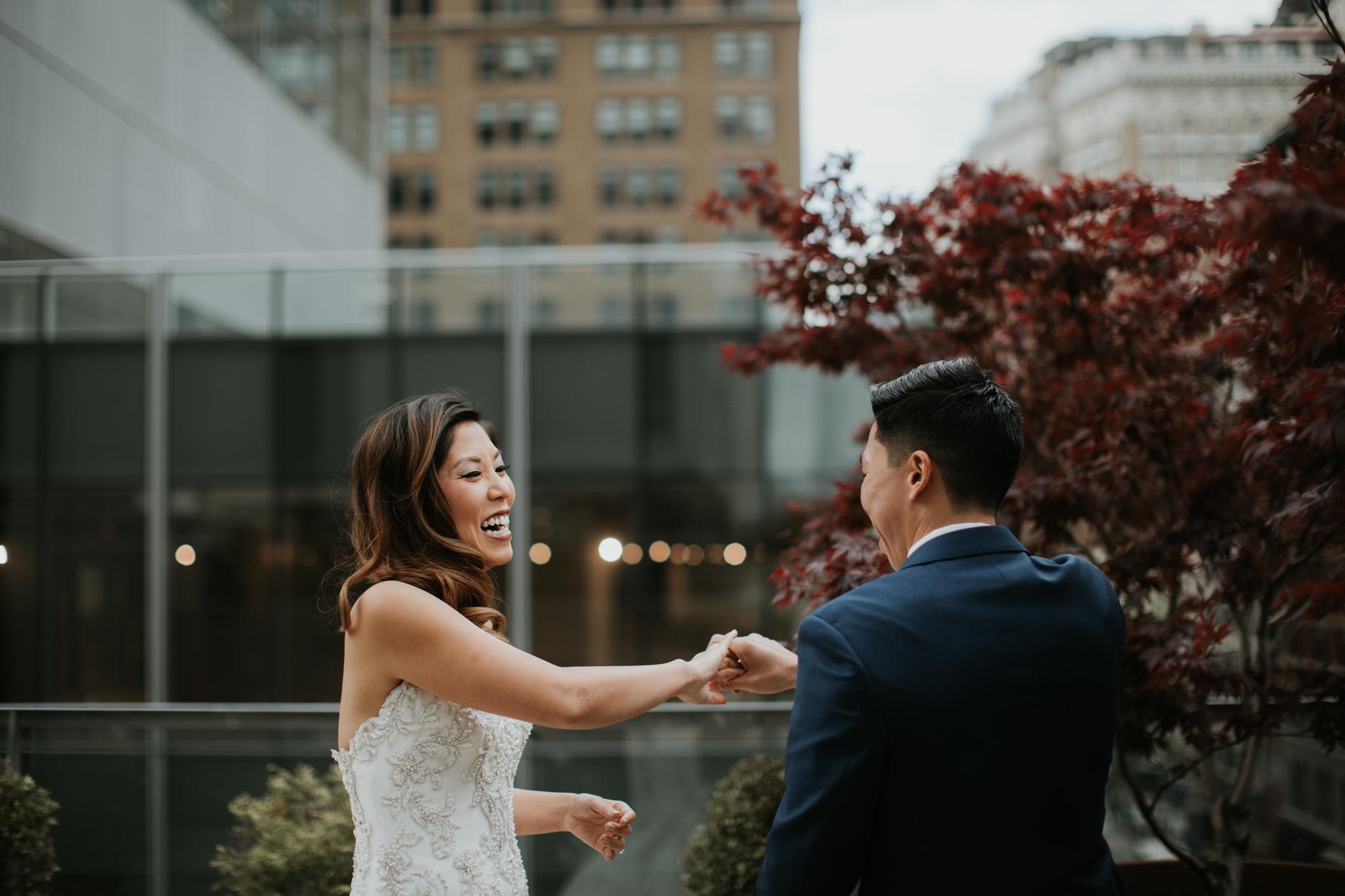 bride and groom having fun nyc