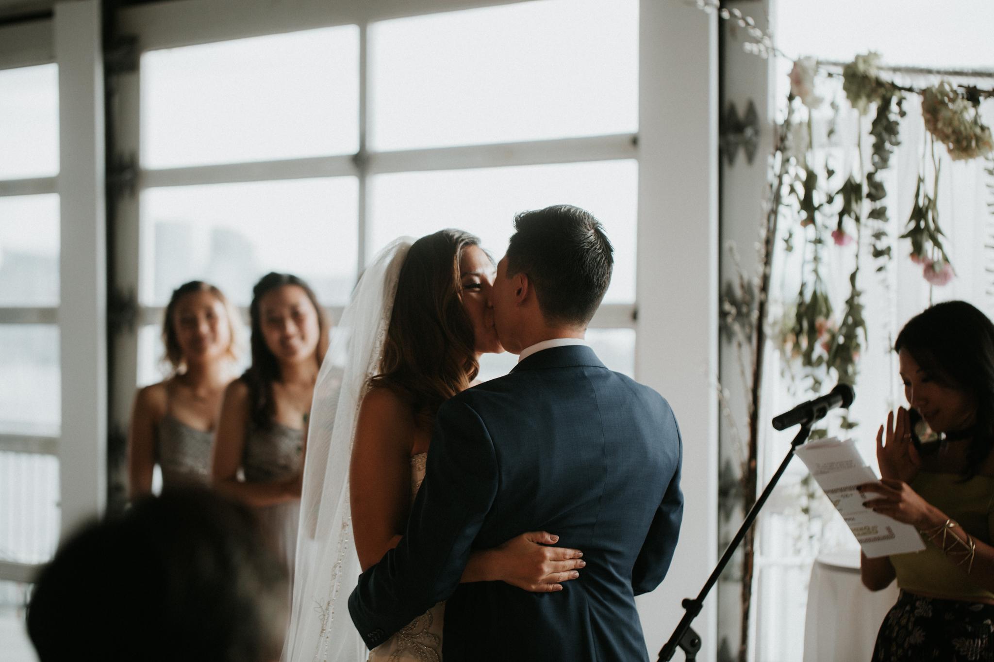 sunset terrace wedding kiss