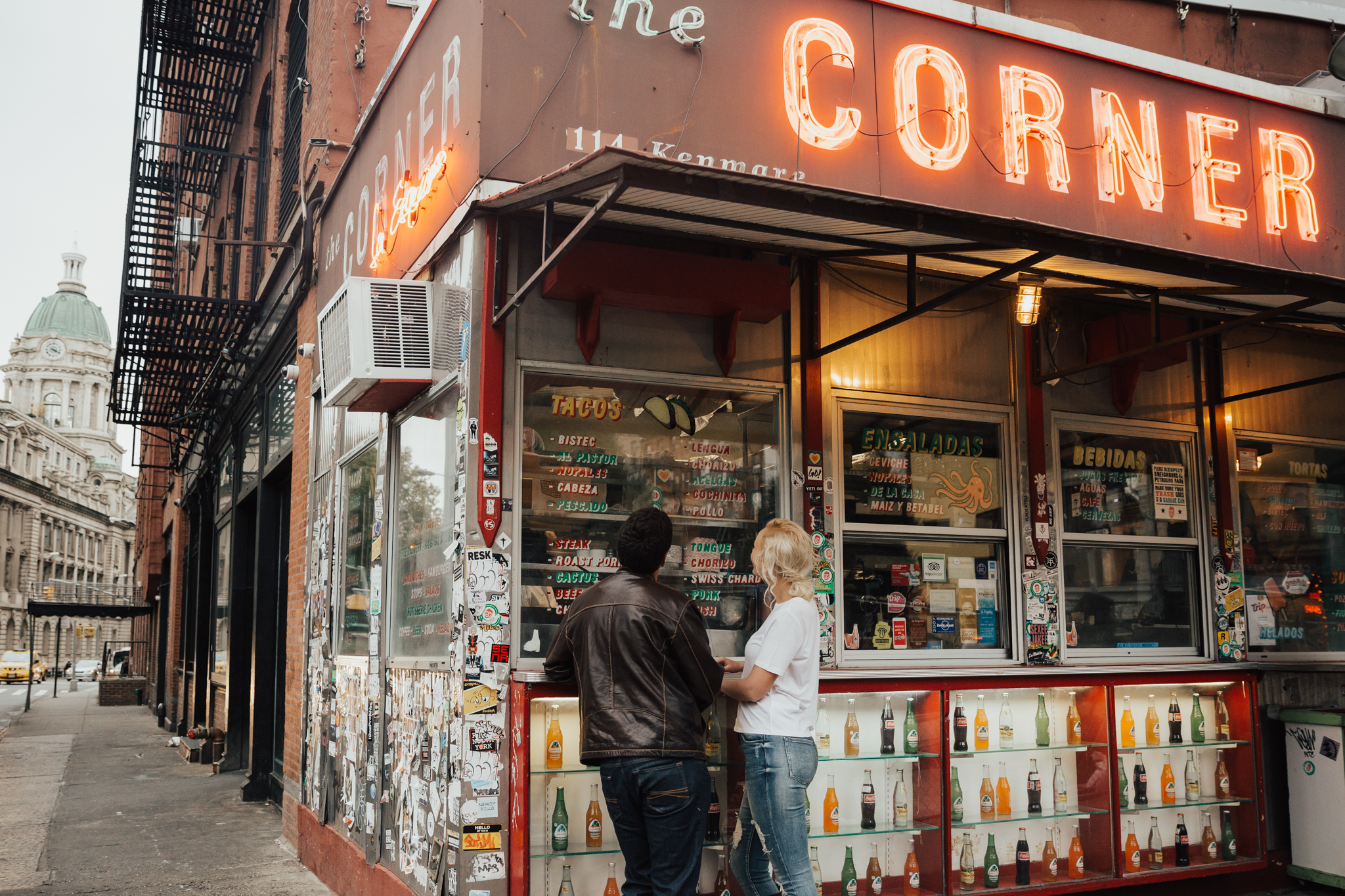 couple in front of la esquina