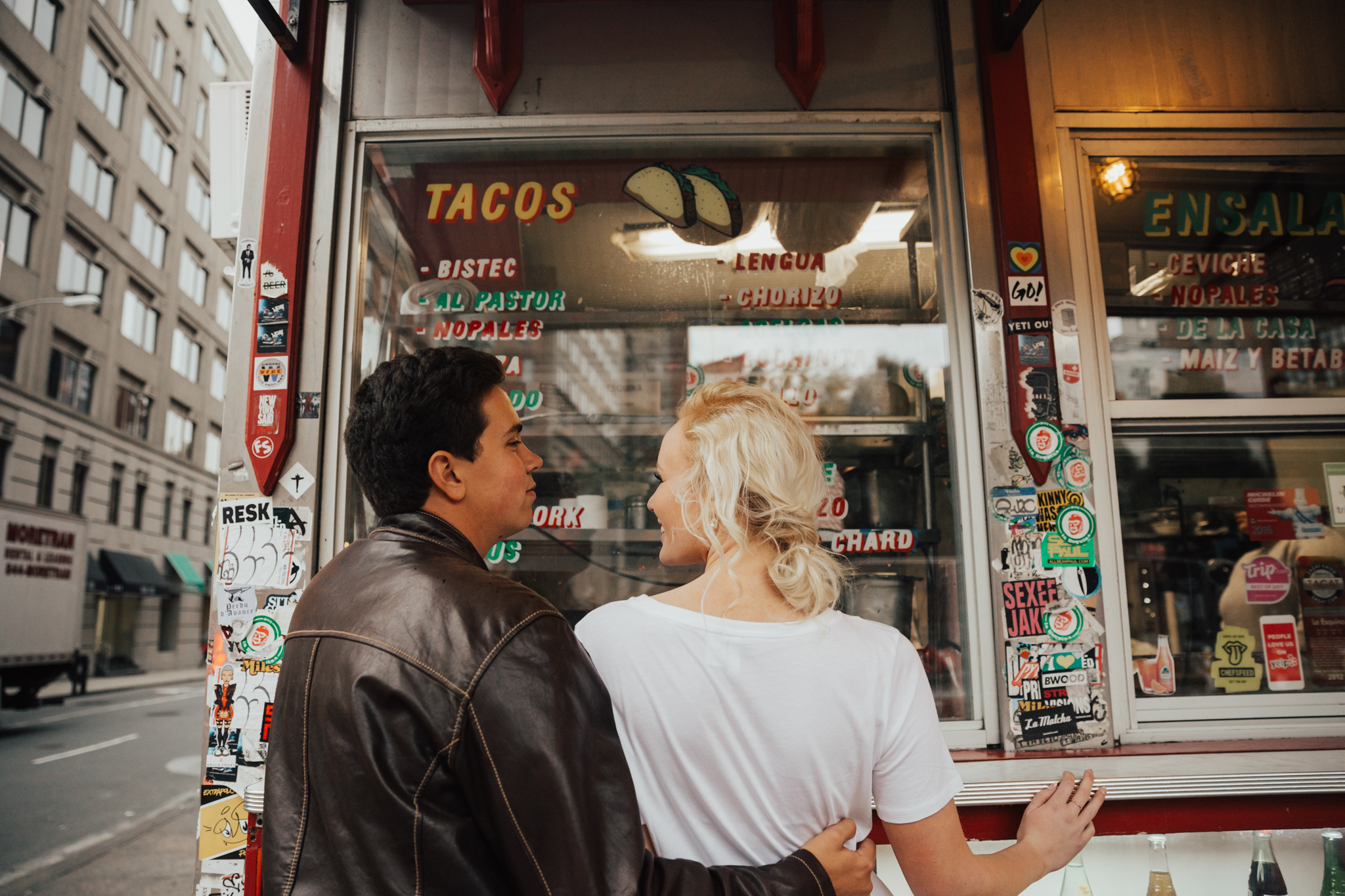 couple ordering tacos