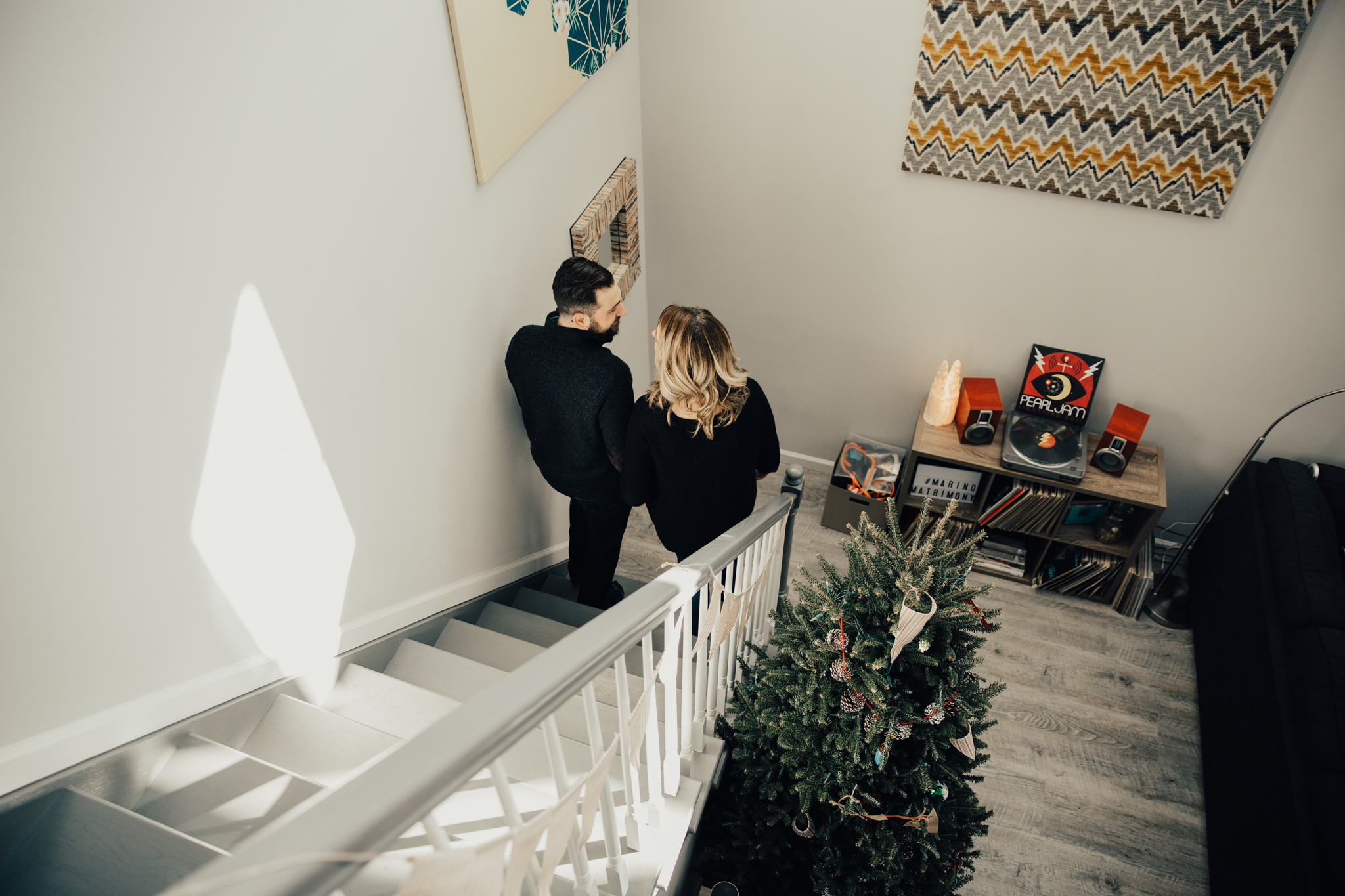 couple walking down stairs in winter cabin