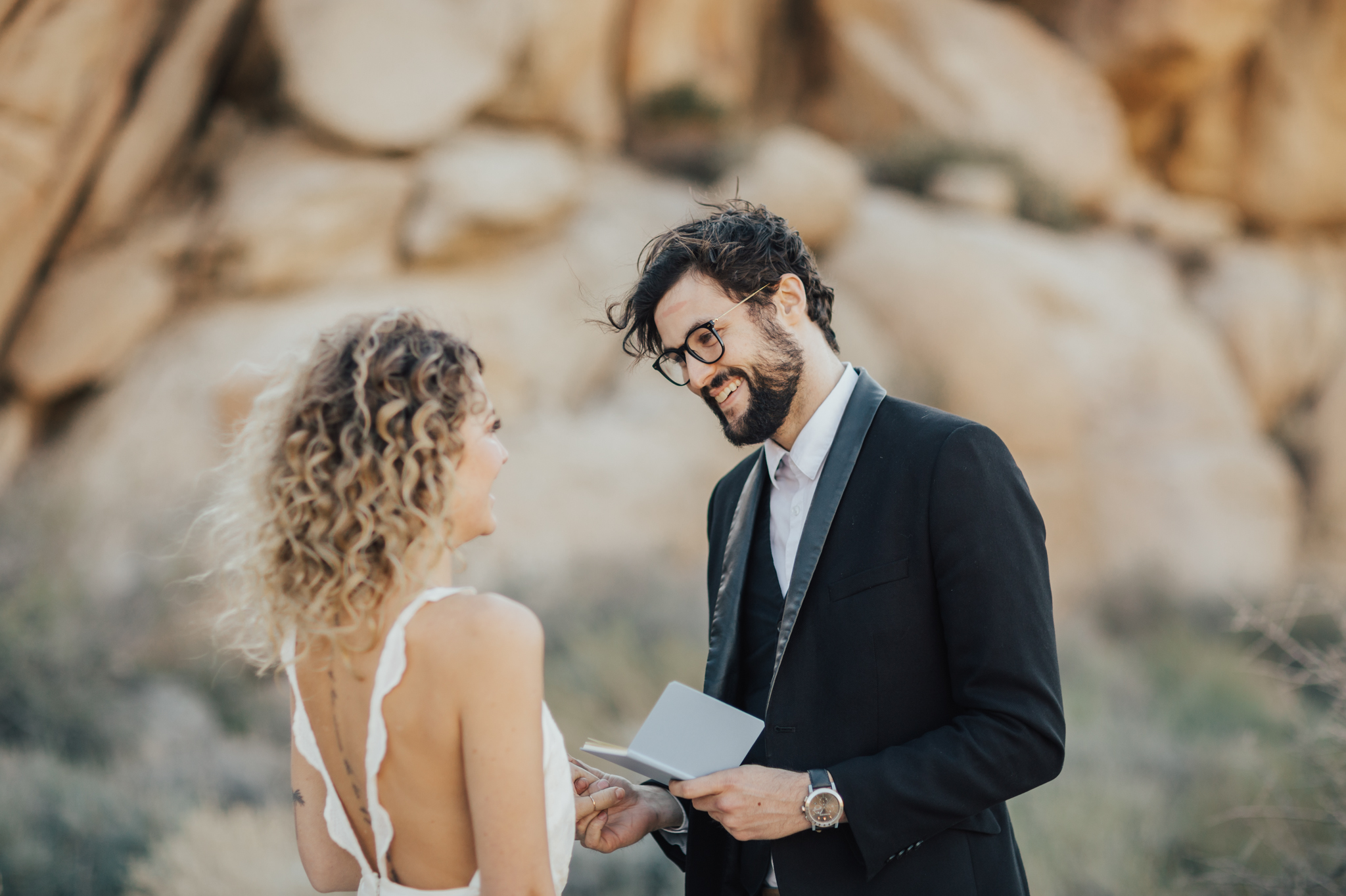 couple exchanging vows elopement