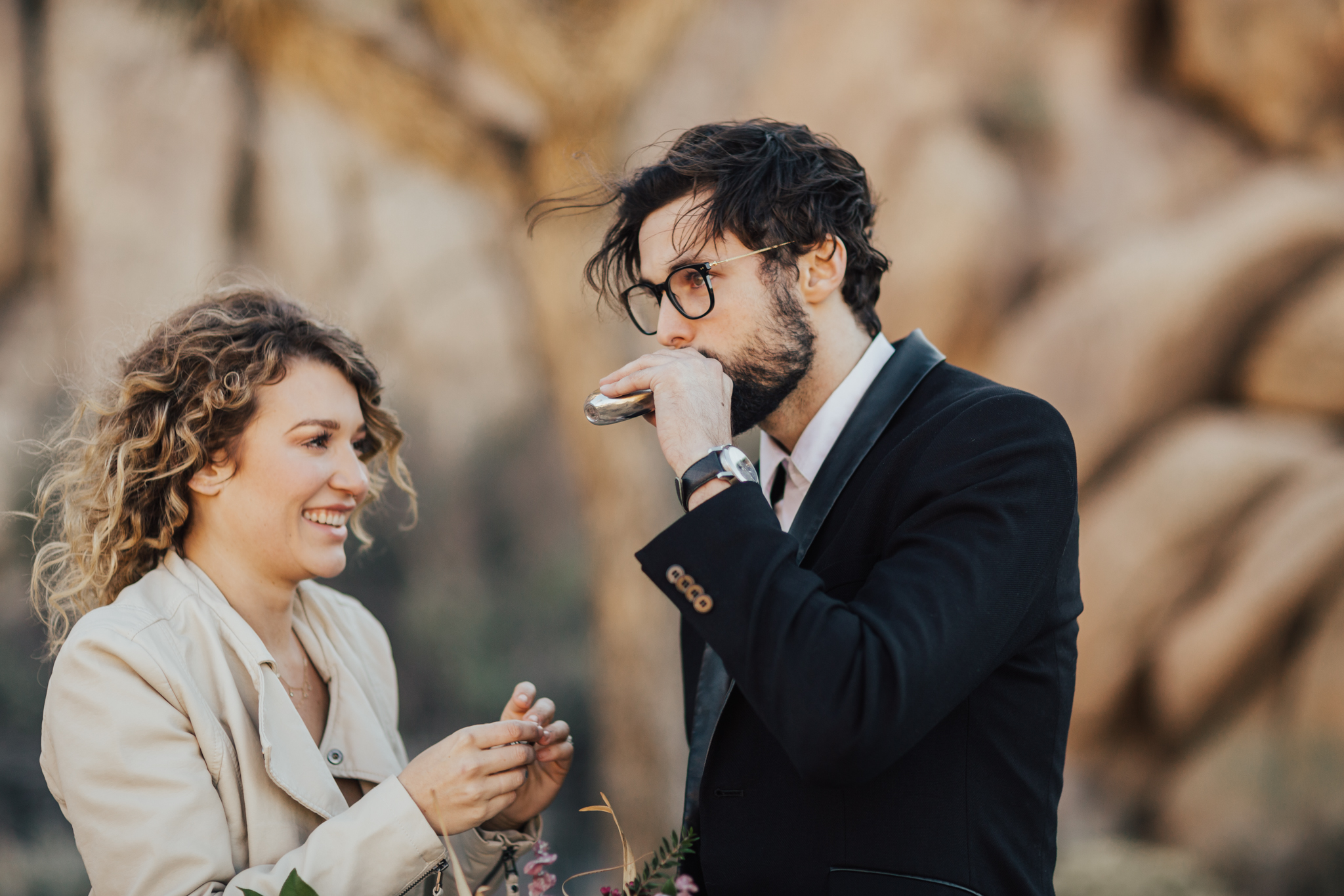 groom drinking from flask